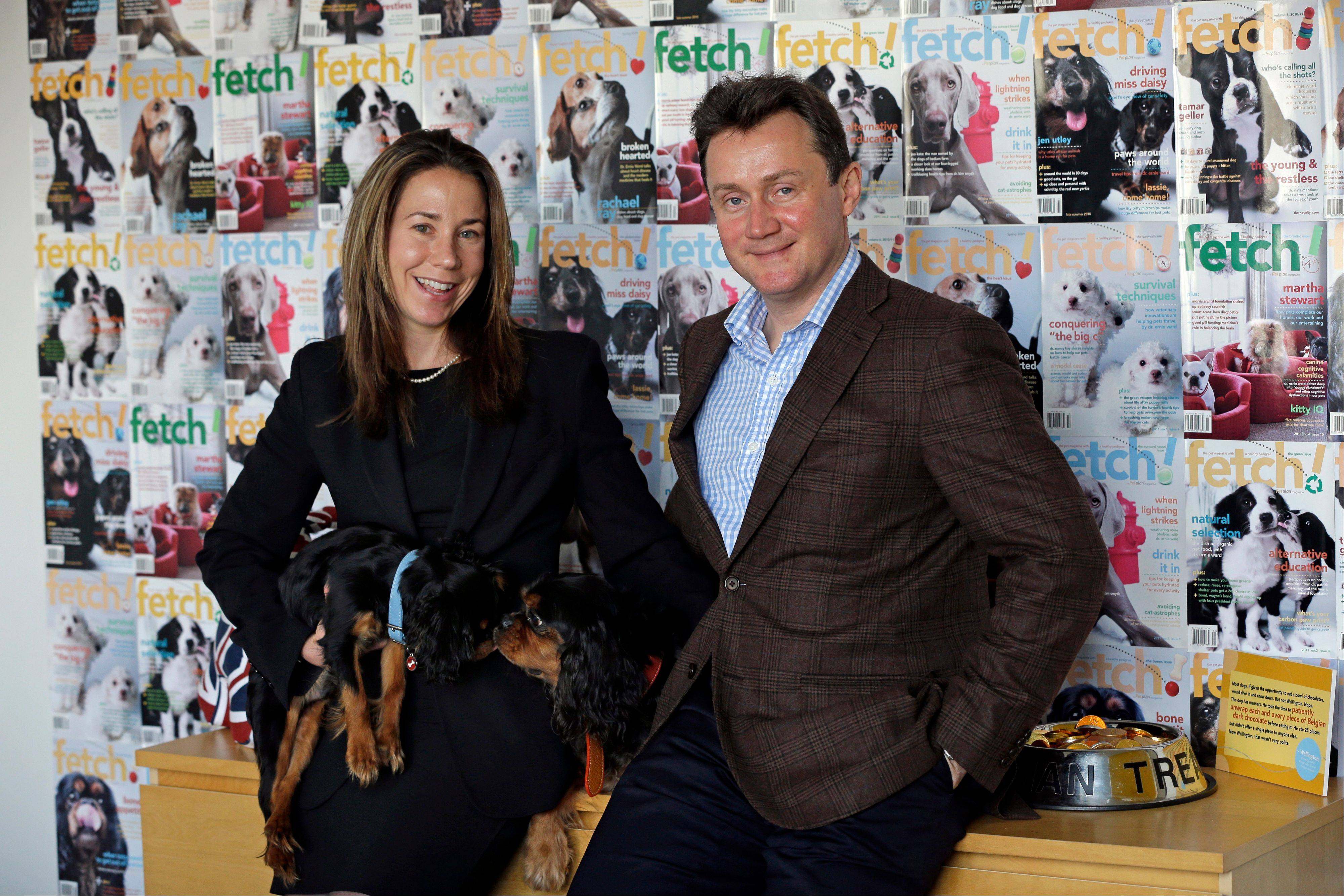 Chris and Natasha Ashton, owners of Petplan, a pet insurance company, pose for a portrait with their dogs, Montgomery, lower left, and Wellington, center, in Philadelphia. Marriage and other long-term relationships aren't easy. And running a small business is no picnic. Putting the two things together can make life complicated for the happiest of life partners. Still, millions of people run businesses with their significant other every day. It's not known how many couples own and run a business together, but the number runs into the millions.