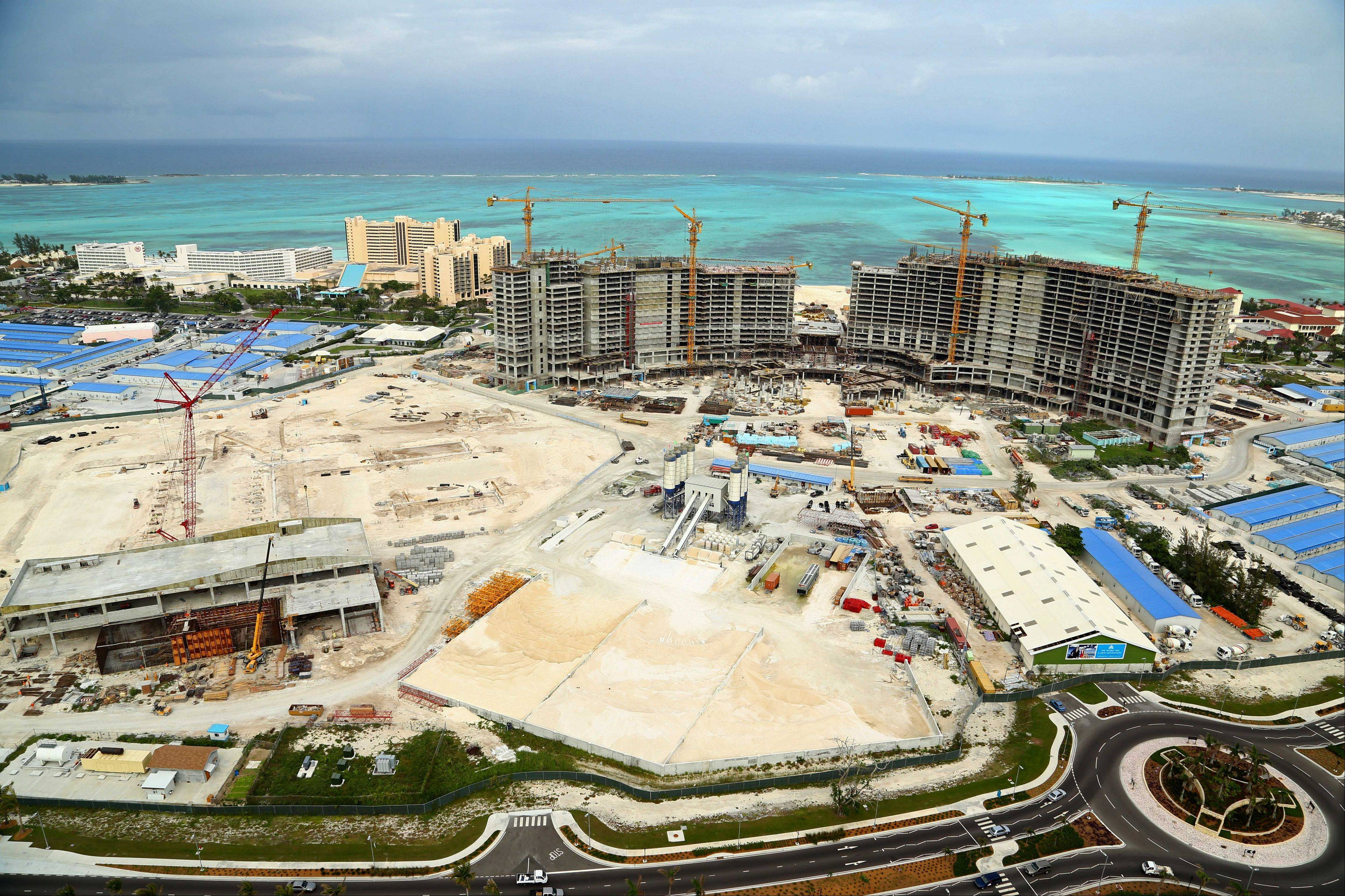 Construction continues on the Baha Mar resort on the beach on New Providence island, Bahamas. The project will add thousands of hotel rooms not far from the islands' biggest resort, the Atlantis. Baha Mar has opened sales offices all over Asia to promote and presell hundreds of pricey condos, hoping to imprint new travel habits on a continent that's traditionally spent beach vacations in Southeast Asia. It is also working with the Bahamian government to open more consular offices in China to issue visas.