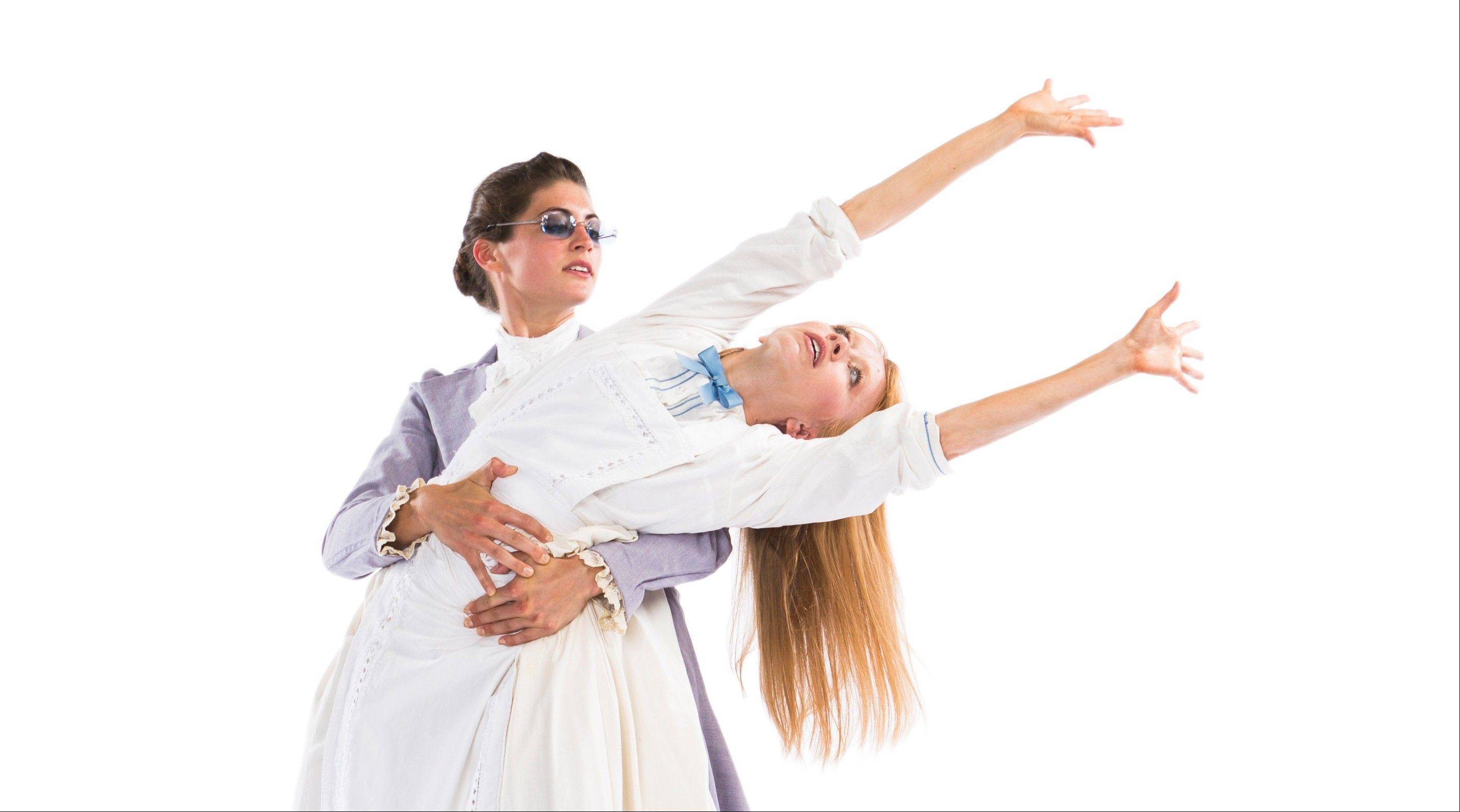 "Jessica Miller Tomlinson (in white) and Alissa Tollefson star in Thodos Dance Chicago's premiere of ""A Light in the Dark,"" based upon the story of Helen Keller and Anne Sullivan, co-choreographed by Melissa Thodos and Ann Reinking."