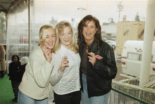 In this Jan. 26, 1997 file photo, country music singers Mindy McCready, left, LeAnn Rimes and Terri Clark joke around after a rehearsal for the American Music Awards at the Shrine Auditorium in Los Angeles. McCready, who hit the top of the country charts before personal problems sidetracked her career, died Sunday, Feb. 17, 2013. She was 37.