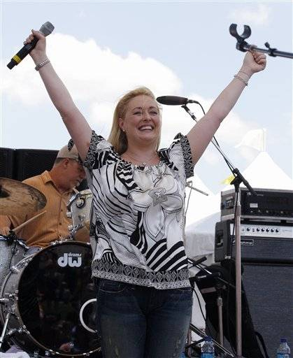In this June 5, 2008 file photo, country music artist Mindy McCready performs at the CMA Music Festival in Nashville, Tenn. McCready, who hit the top of the country charts before personal problems sidetracked her career, died Sunday, Feb. 17, 2013. She was 37.