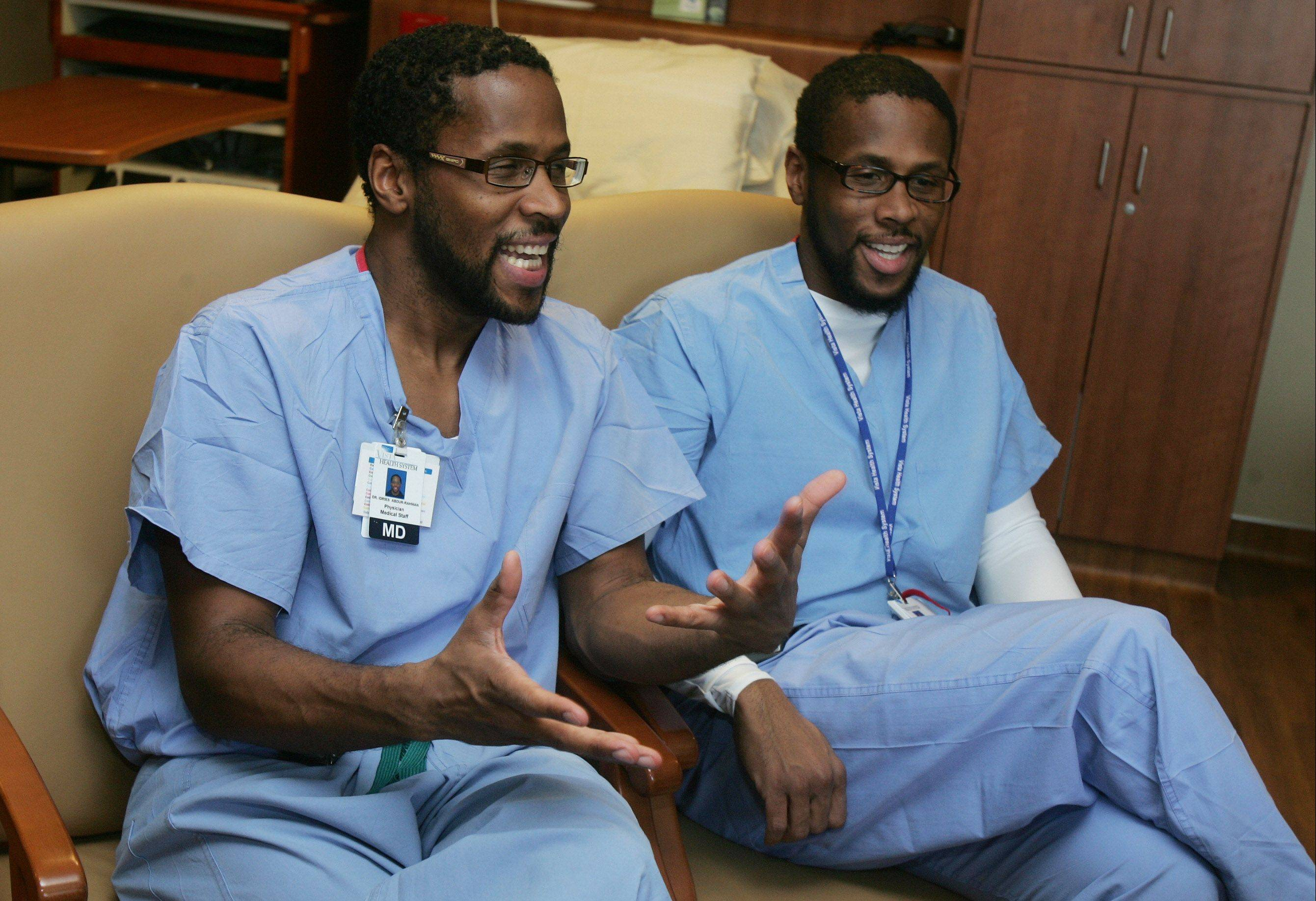 "Chatting in one of new delivery rooms at Vista Medical Center East in Waukegan, twin doctors Idries, left, and Jamil Abdur-Rahman say the rigors of med school and their background help them as contestants on TV's ""The Amazing Race."""