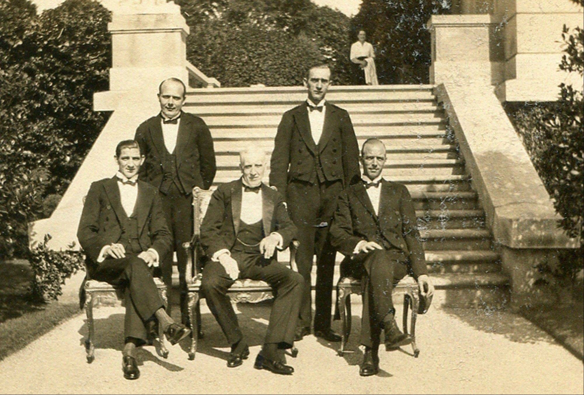 "Butler Ernest Birch, center, surrounded by footmen next to the terrace of The Elms mansion in Newport, R.I. Newly discovered photographs, documents and family histories have inspired the creation of a tour about servants at The Elms, echoing themes of the British drama program, ""Downton Abbey."""