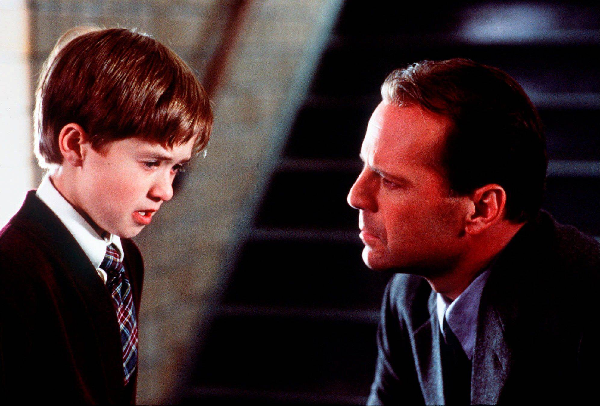 "Haley Joel Osment, left, and Bruce Willis in a scene from the film ""The Sixth Sense."""