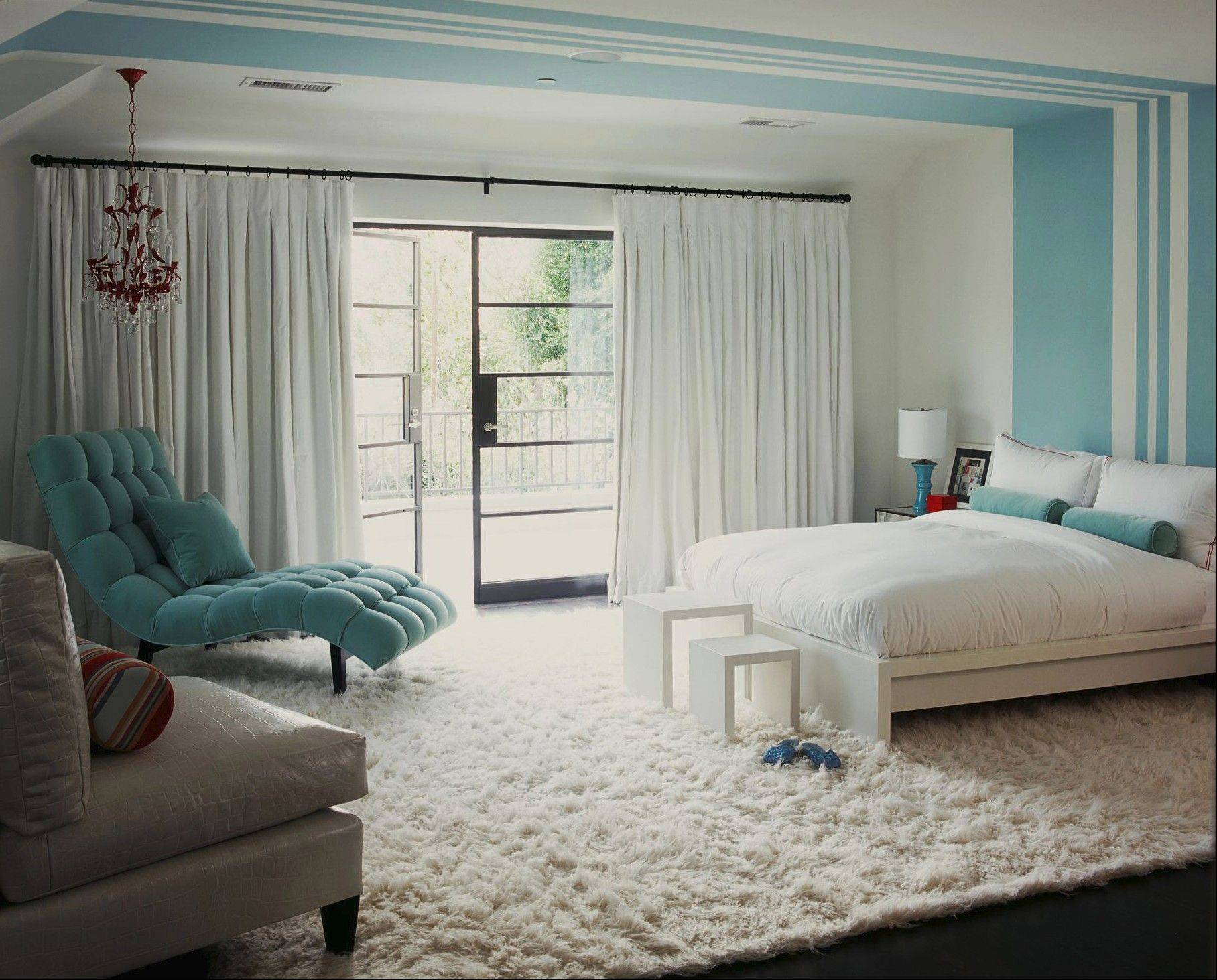 Designer Betsy Burnham chose walls of pure white and frosty blue to complement the fluffy snow-white flokati rug.