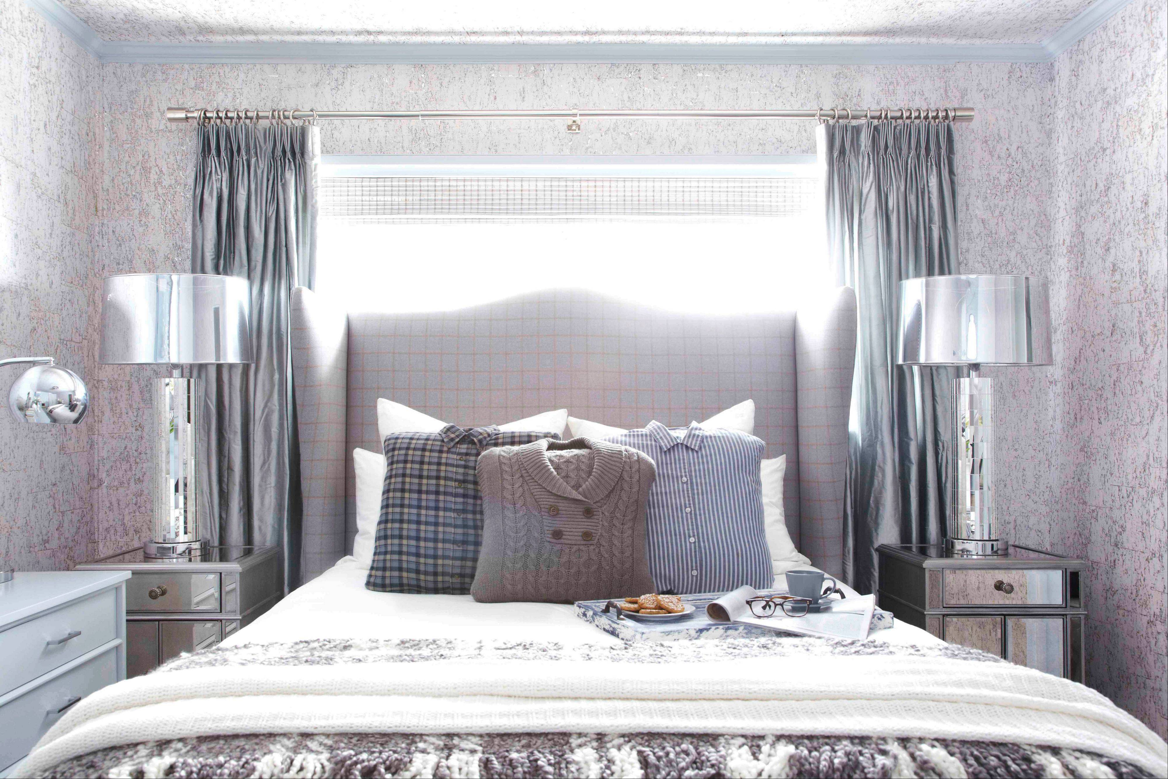 Designer Brian Patrick Flynn of HGTV.com turns to wintry menswear for inspiration when creating wintry spaces. It includes a custom headboard made from men's suiting fabric featuring a check print, as well as pillows made from hand-me-down sweaters and flannel shirts.