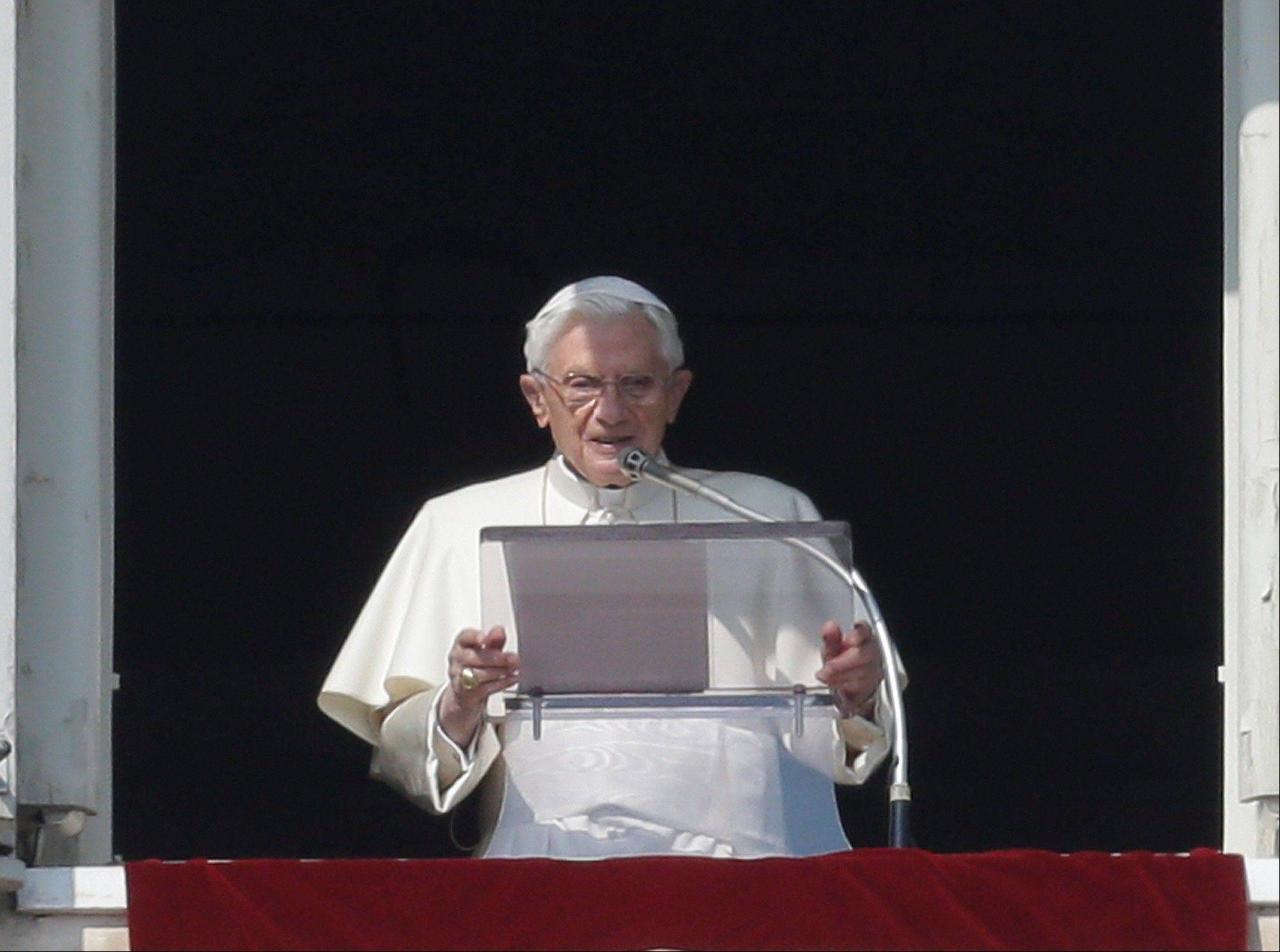 Pope Benedict XVI reads his message during the Angelus noon prayer he celebrated from the window of his studio overlooking St. Peter's square at the Vatican, Sunday, Feb. 17, 2013. The Pontiff blessed the faithful for the first time since announcing his resignation, cheered by an emotional crowd of tens of thousands of well-wishers from around the world.