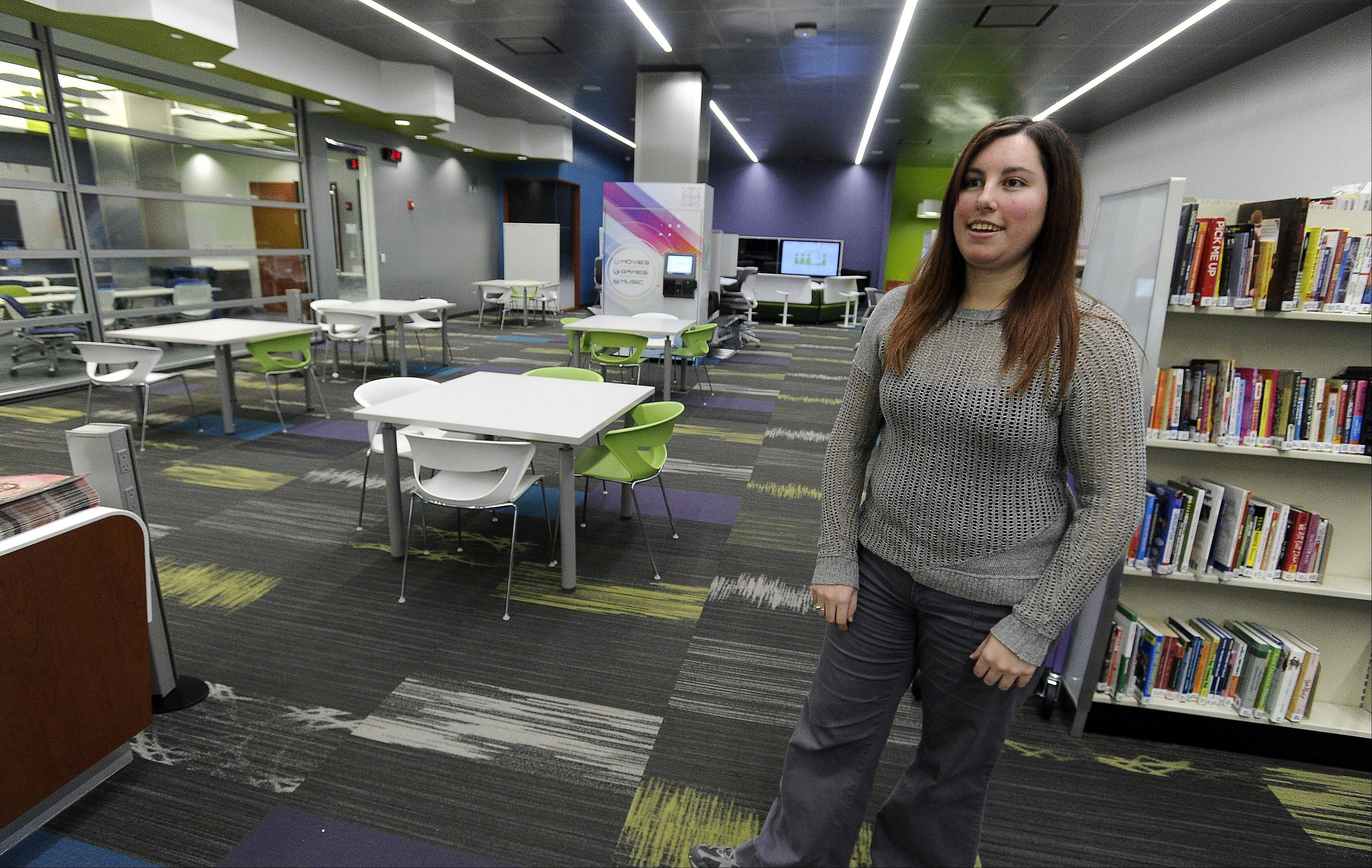 Katie LaMantia, teen librarian, shows off the new teen center at the Schaumburg Township District Library which is open for teens up to 19 for computer use or movie production.