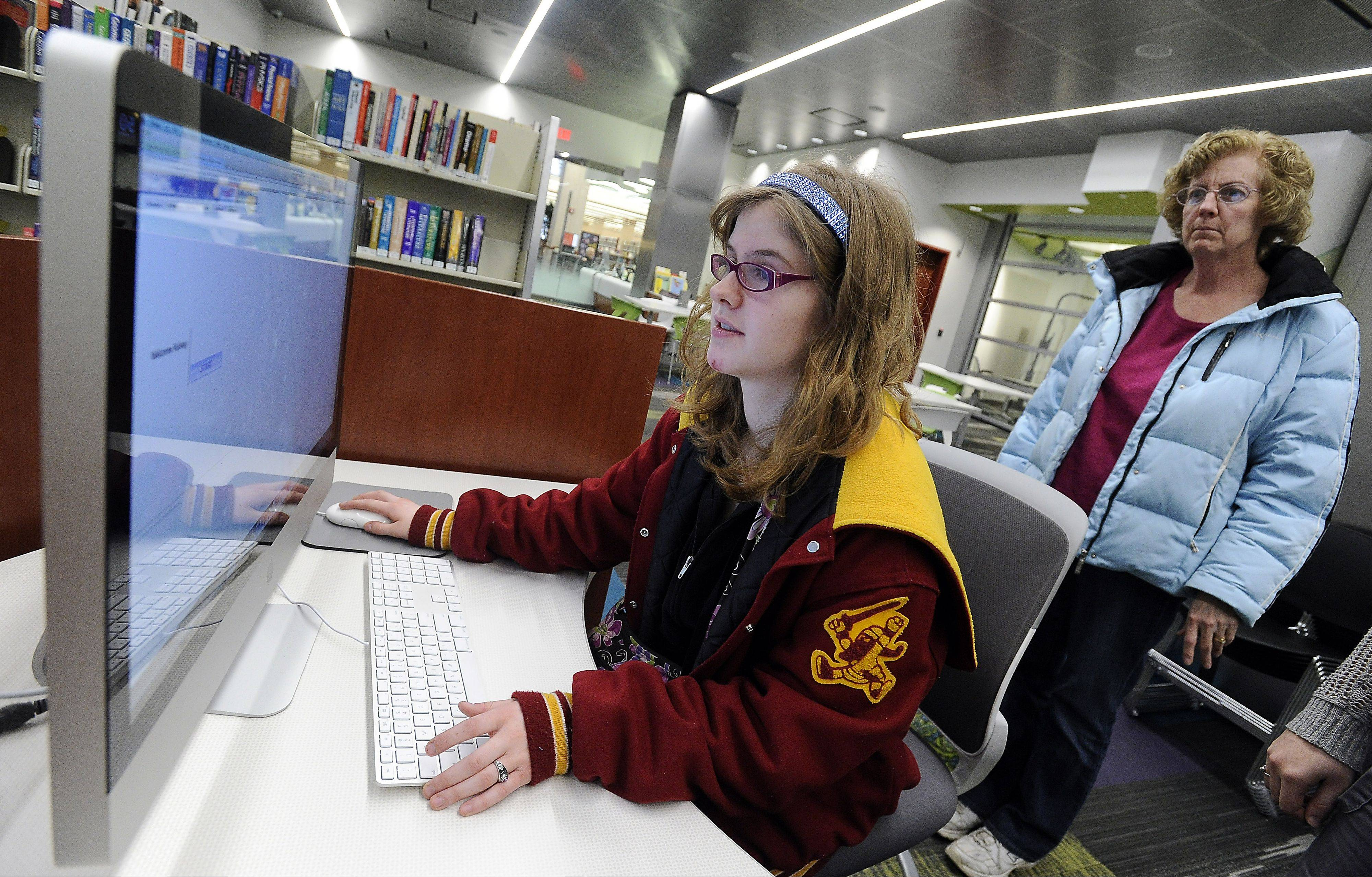 Kelsey Louro, 17, of Hoffman Estates High School, and her mom, Laura, look up school information at the Schaumburg Township District Library.
