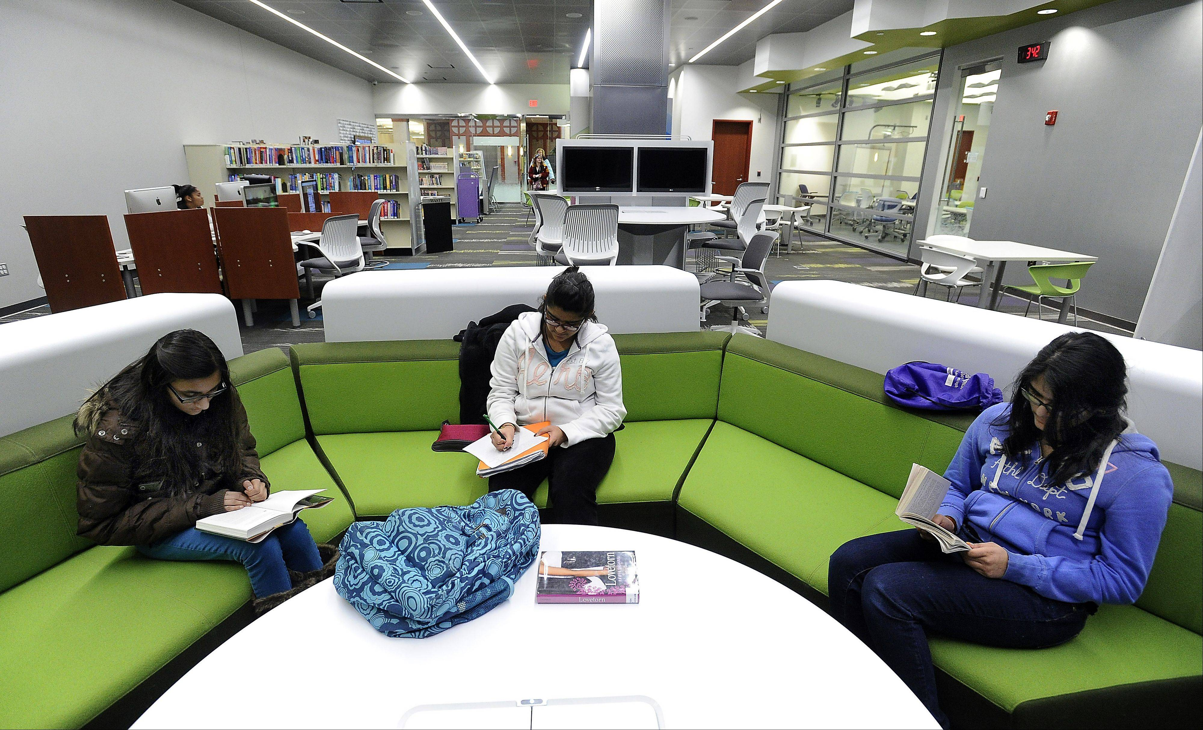 Puja, 13, Toral, 14, and Komal Patel, 12, like to read in the new teen center at the Schaumburg Township District Library.