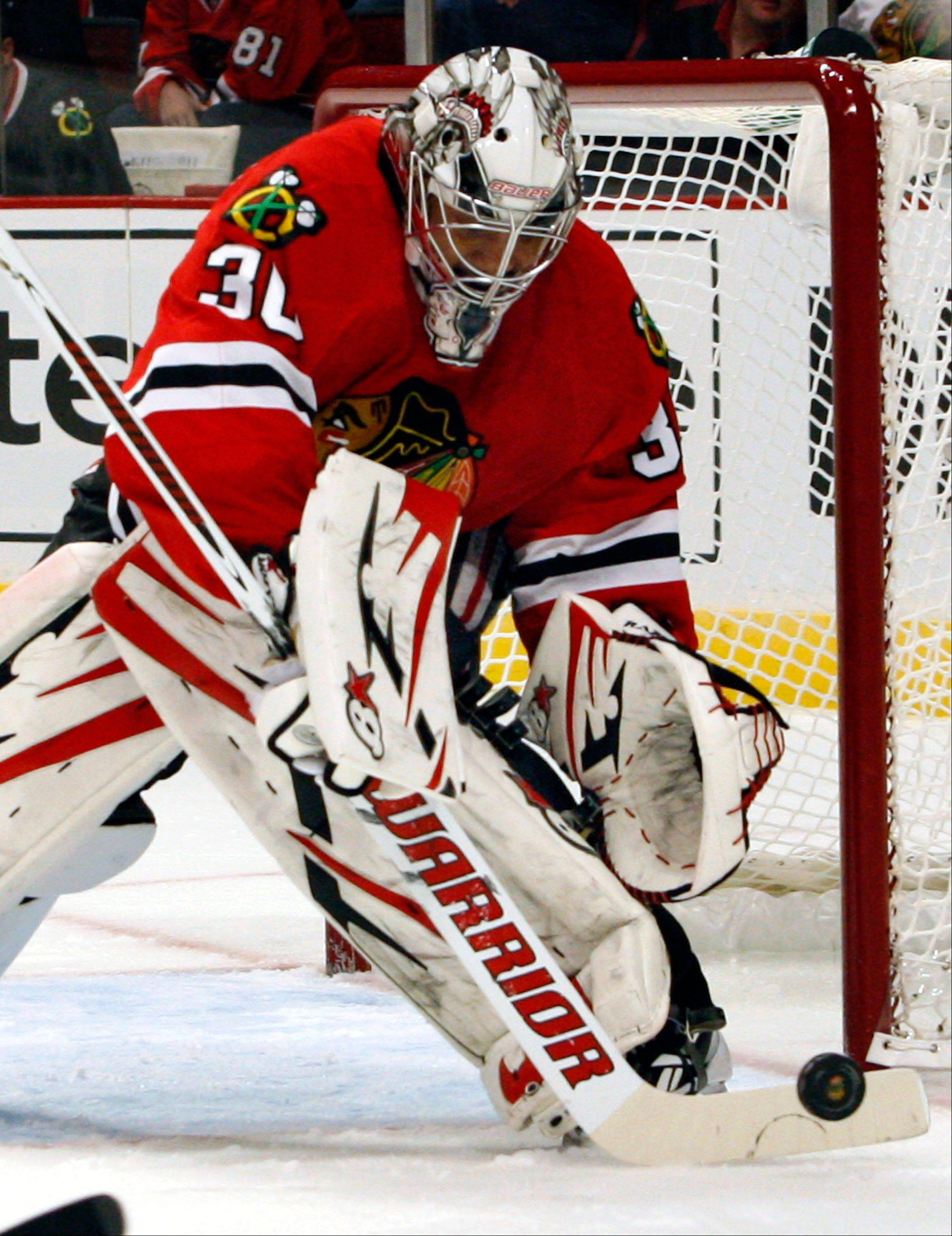 Blackhawks goalie Ray Emery stops a shot from the Los Angeles Kings in the first period of Sunday's 3-2 Hawks victory at the United Center.