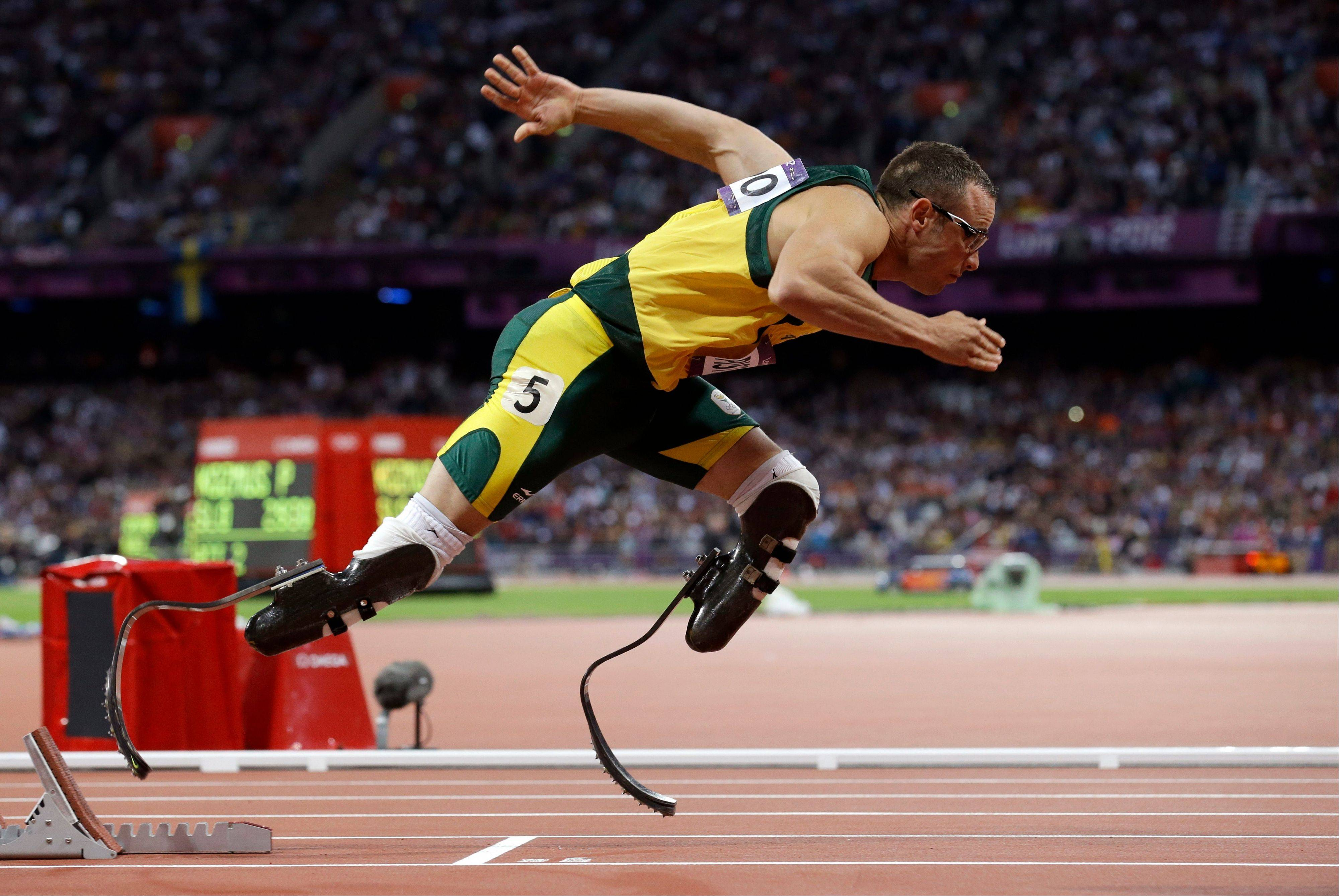 In this Aug. 5, 2012, file photo, South Africa's Oscar Pistorius starts in the men's 400-meter semifinal during the athletics in the Olympic Stadium at the 2012 Summer Olympics in London. Paralympic superstar Oscar Pistorius was charged Thursday with the murder of his girlfriend who was shot inside his home in South Africa, a stunning development in the life of a national hero known as the Blade Runner for his high-tech artificial legs.