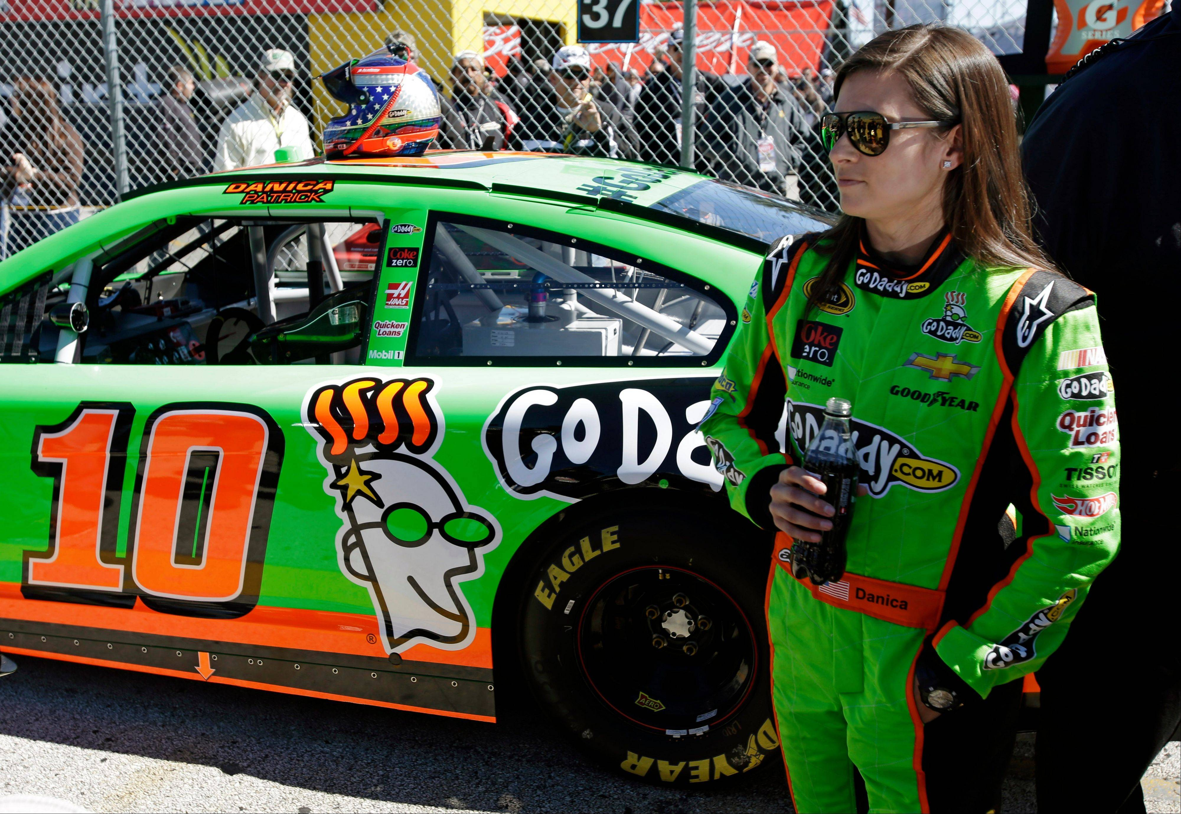 Danica Patrick stands by her car after qualifying for the NASCAR Daytona 500 Sprint Cup Series auto race at Daytona International Speedway, Sunday, in Daytona Beach, Fla. Patrick won the pole, becoming the first woman to secure the top spot for any Sprint Cup race.
