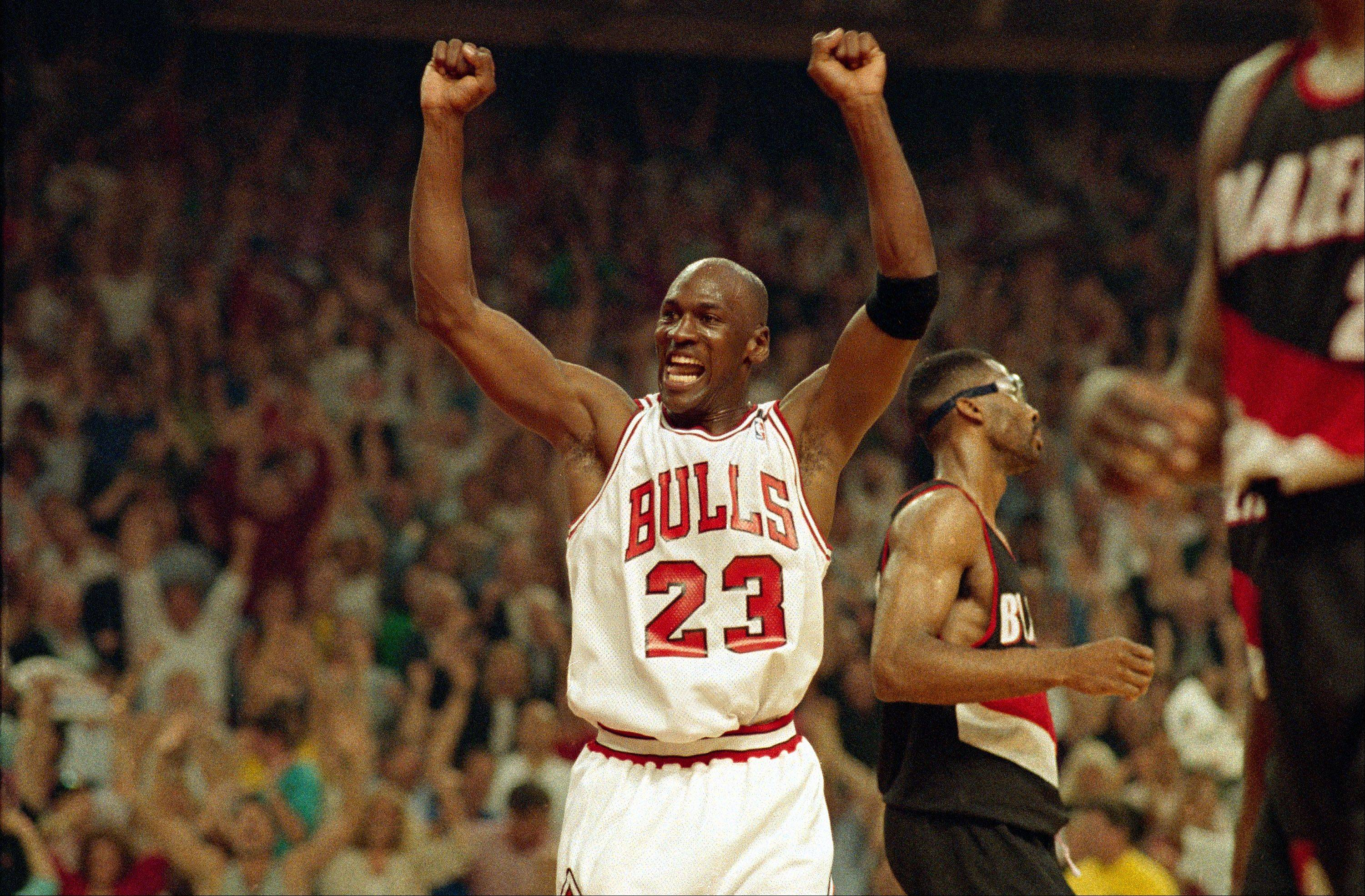 Michael Jordan celebrates the Bulls' win over the Portland Trail Blazers in the NBA Finals in Chicago, June 14, 1992. The Bulls beat the Trail Blazers 97-93 to repeat as champions.