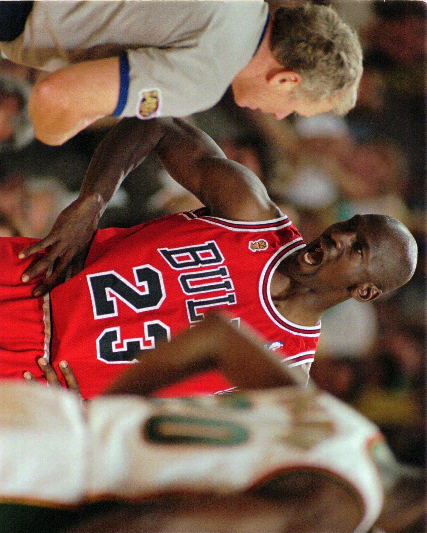 Michael Jordan has words with referee Mike Mathis, left, during the second quarter of Game 4 in the NBA Finals, Wednesday evening, June 12, 1996, in Seattle.