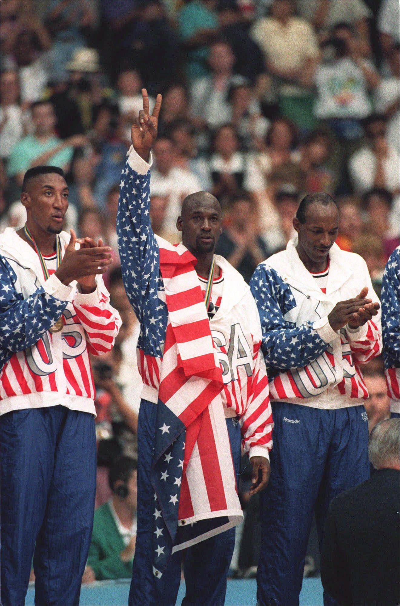 The USA's Scottie Pippen, left, with Michael Jordan, center, and Clyde Drexler, pose with their gold medals after beating Croatia 117-85 in Olympic basketball at Barcelona, Aug. 8, 1992.