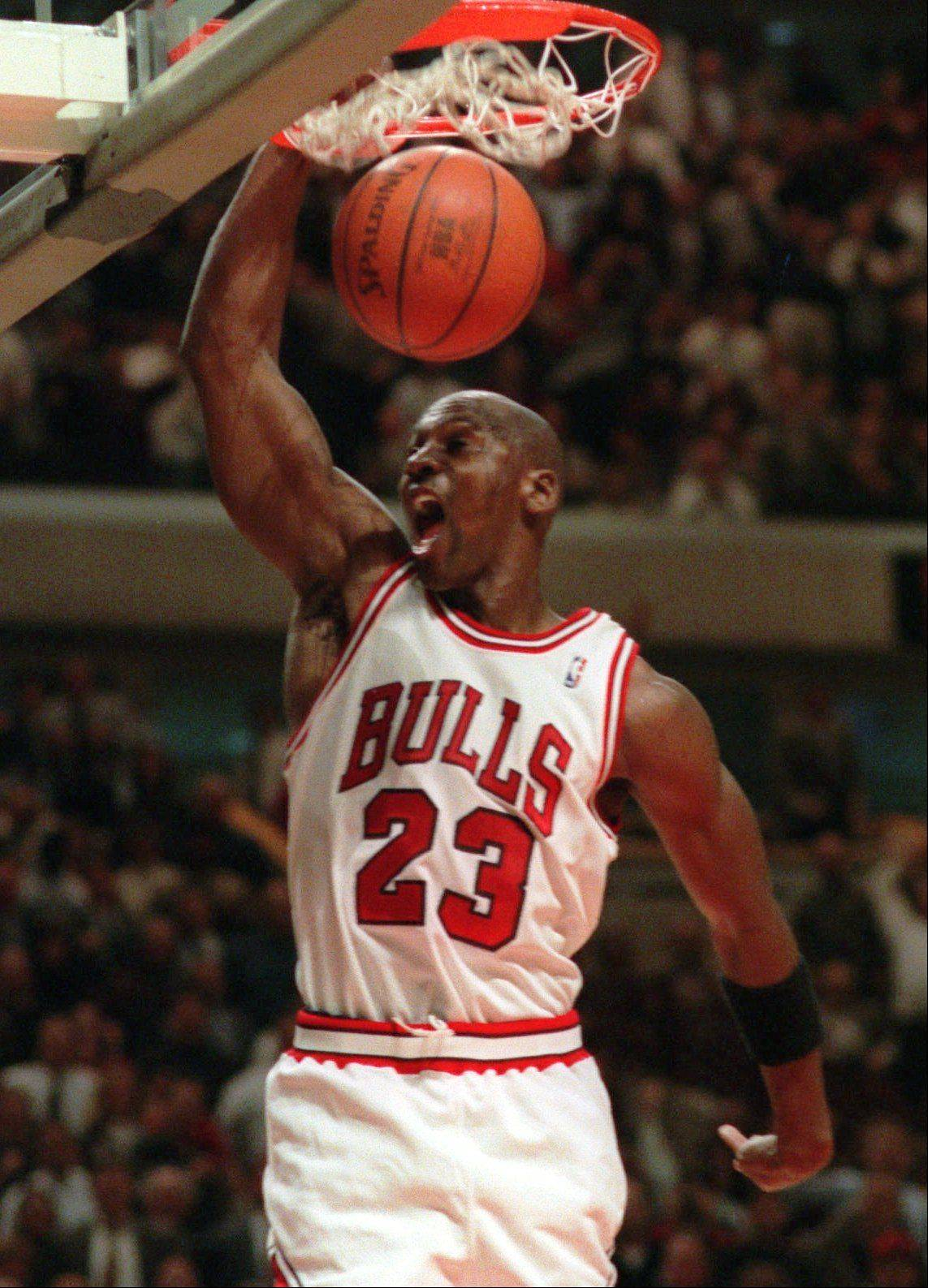 Michael Jordan slams the ball through the net during a Dec. 6, 1995, game against the New York Knicks in Chicago.