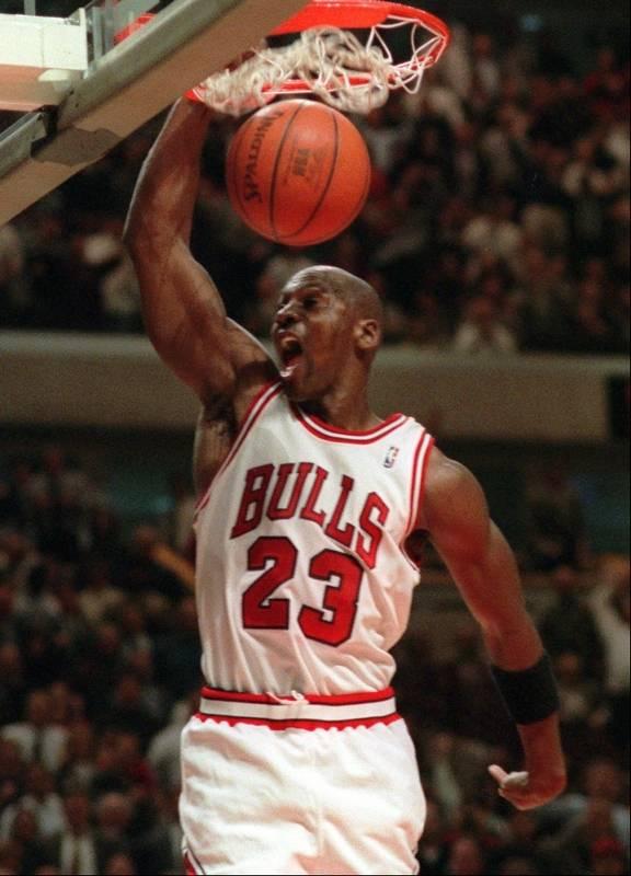 Michael Jordan Slams The Ball Through Net During A Dec 6 1995