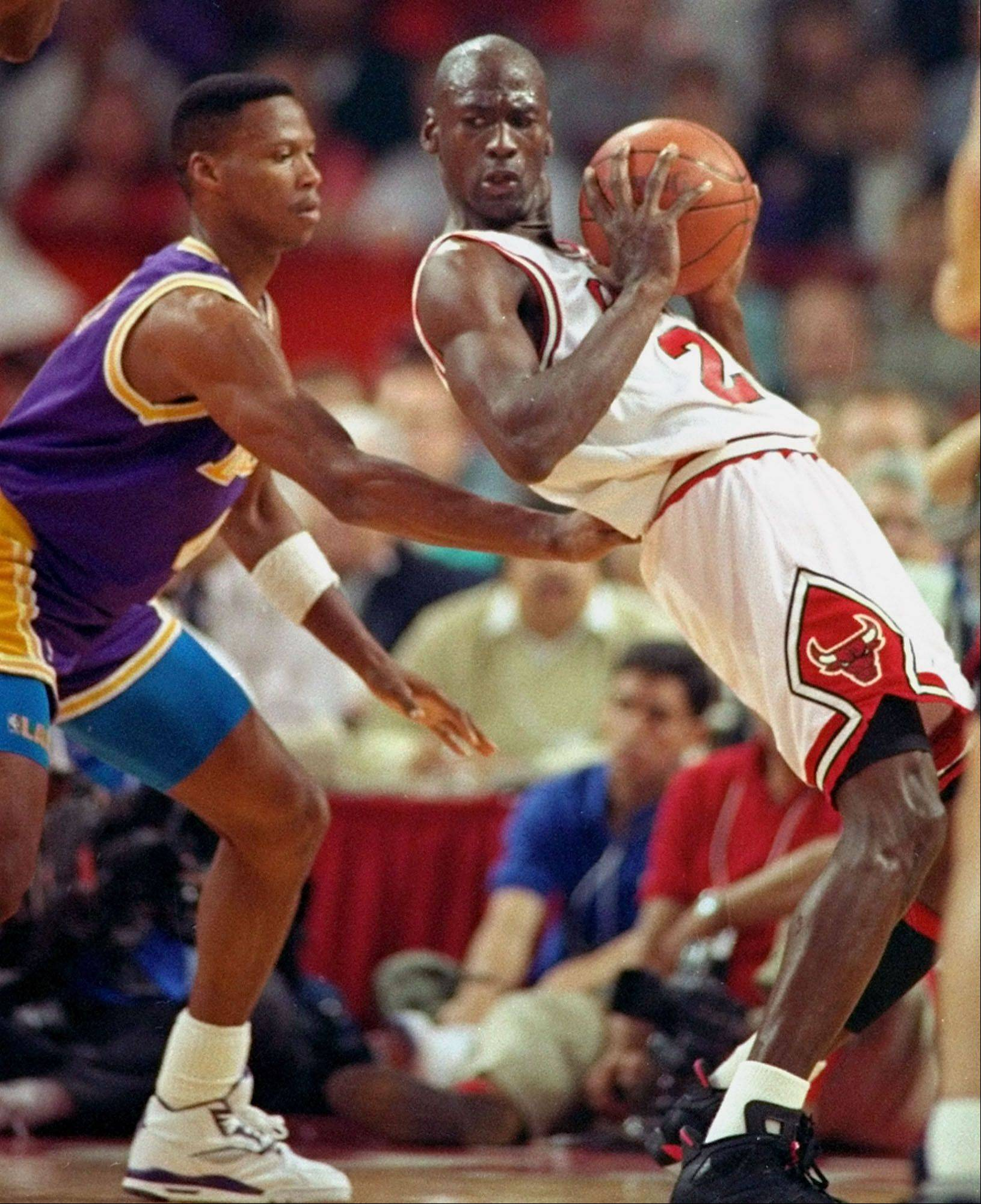 Los Angeles Laker guard Byron Scott, left, checks Michael Jordan during the third quarter of Game 2 of the NBA Finals in Chicago.