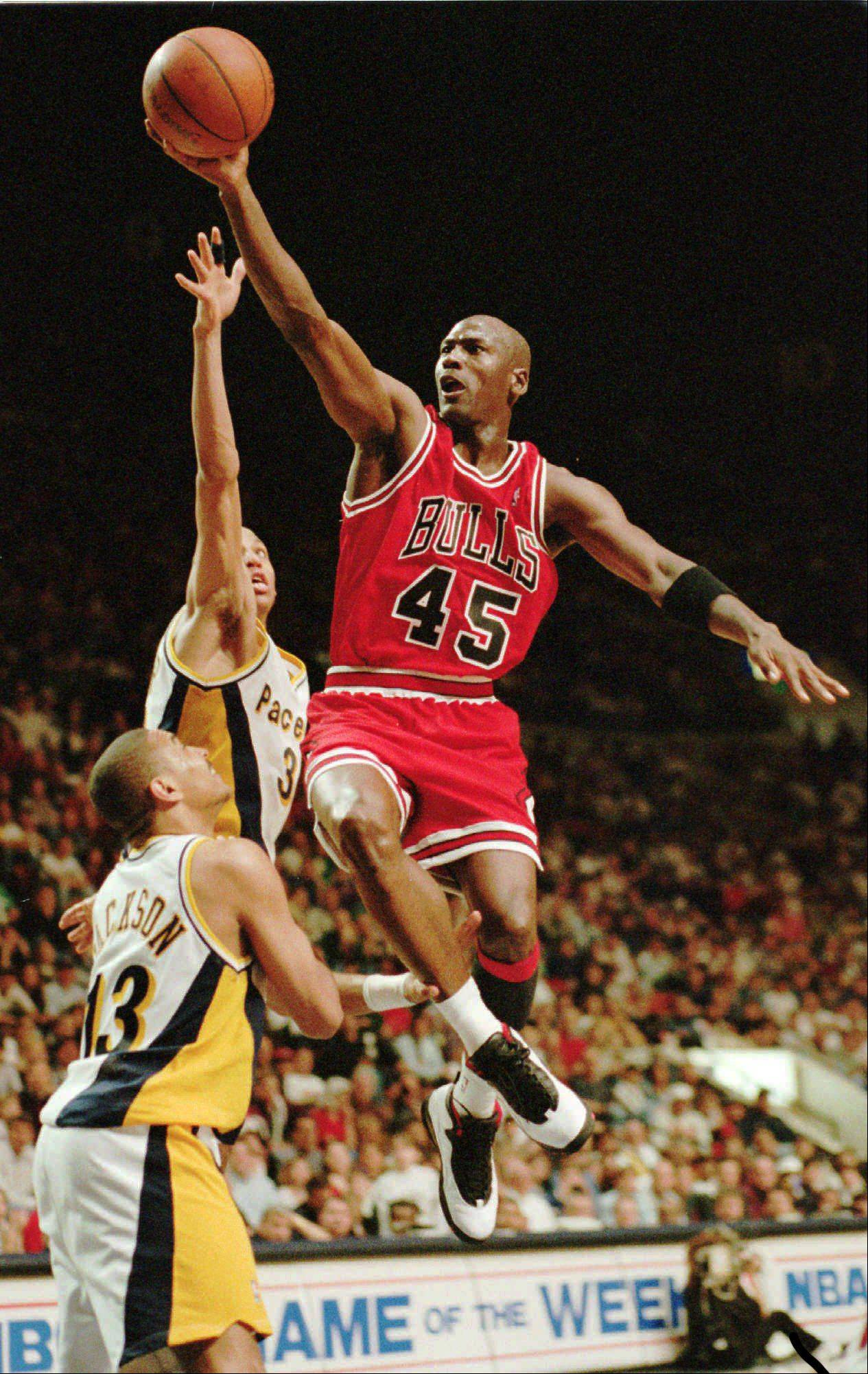 "Michael Jordan flies to the hoop over the Indiana Pacers' Reggie Miller and Mark Jackson (13), March 19, 1995, in Indianapolis, Ind. Nicknamed ""Air Jordan"" for his superb athleticism, he was named the National Basketball Association's Most Valuable Player in 1988, 1991, 1992, 1996 and 1997."
