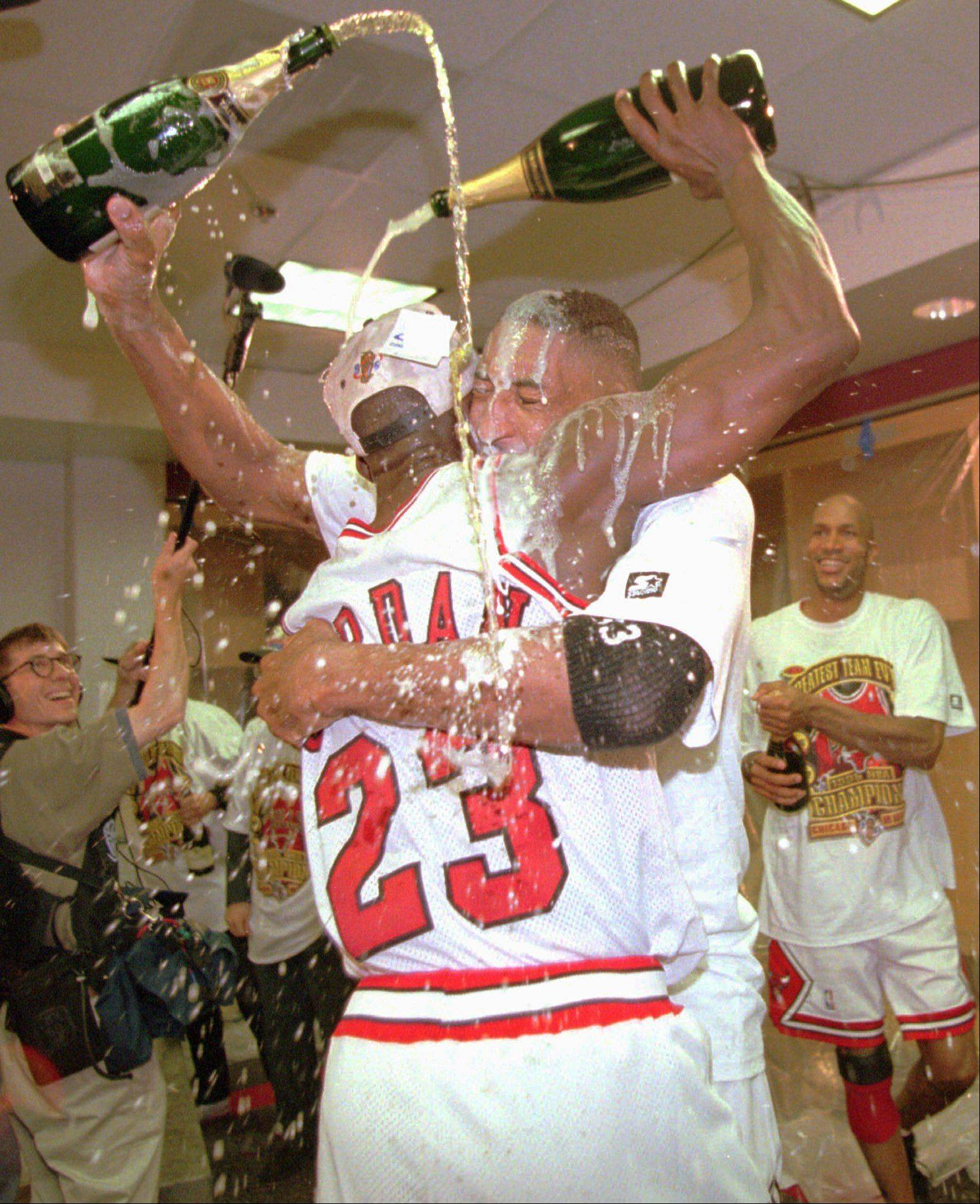 Michael Jordan, left, and Scottie Pippen celebrate with champagne in the locker room after they defeated the Seattle SuperSonics , 87-75, in Game 6 to win the NBA Championship Sunday, June 16, 1996, in Chicago.