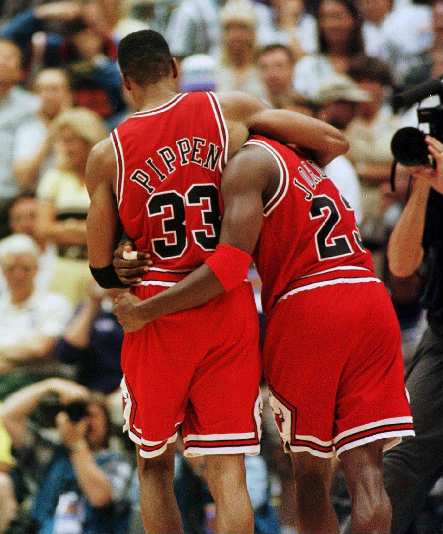 Bulls Scottie Pippen helps an exhusted Michael Jordan off the court in the final seconds of Game 5.