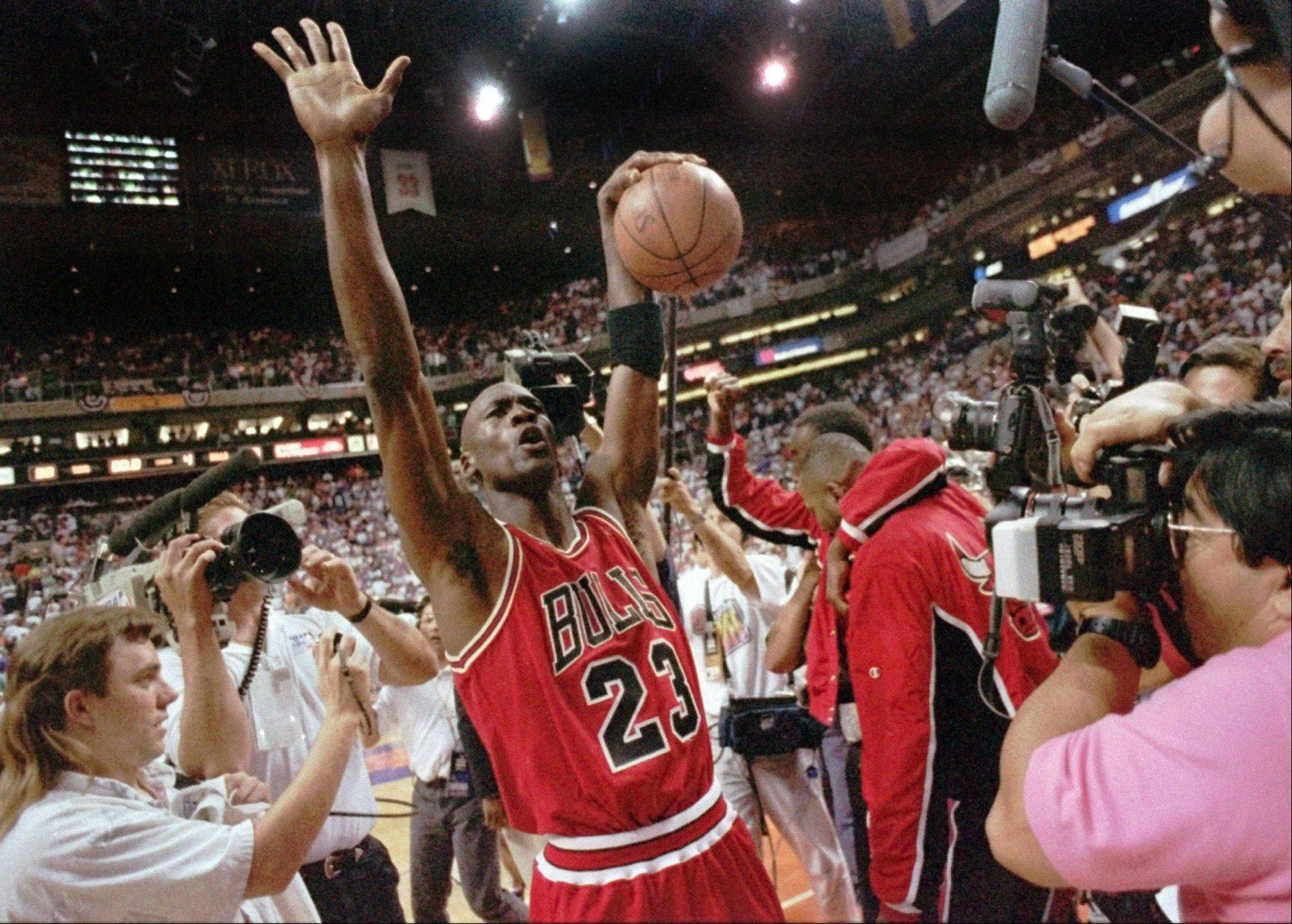 Michael Jordan celebrates after the Bulls beat the Phoenix Suns 99-98 to win their third consecutive NBA title in Phoenix, June 20, 1993. Jordan scored 33 points and now holds the record for the highest scoring average in finals history, 41.0, eclipsing Rick Barry's 1967 standard of 40.8.