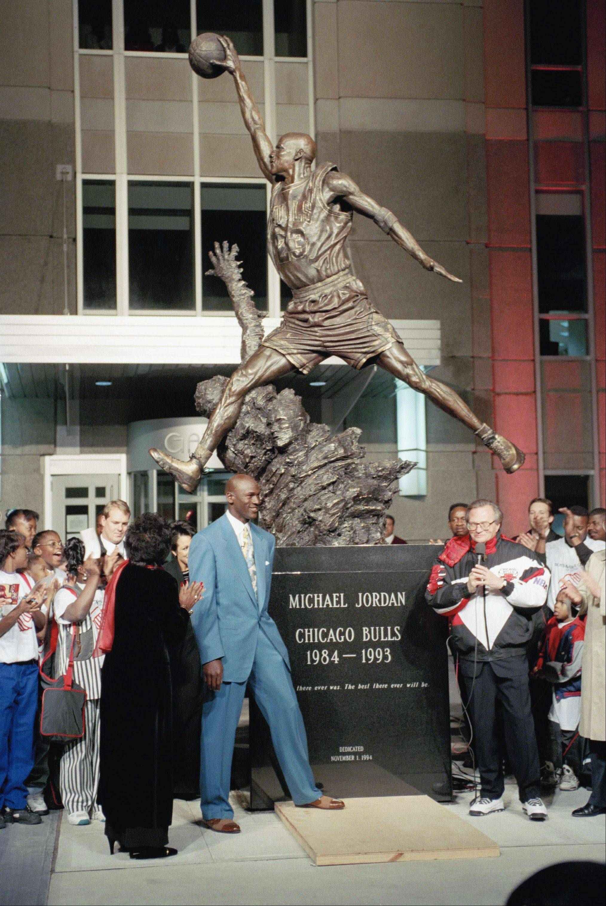 Michael Jordan and his mother Deloris Jordan at the unveiling of his statue at the United Center.