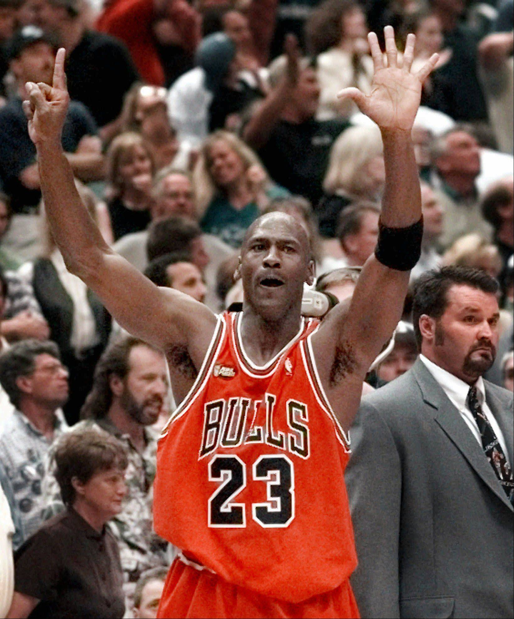 Chicago Bulls guard Michael Jordan holds up six fingers for the six NBA Championships the Bulls have won after Chicago defeated 87-86 in Salt Lake City, Sunday, June 14, 1998.