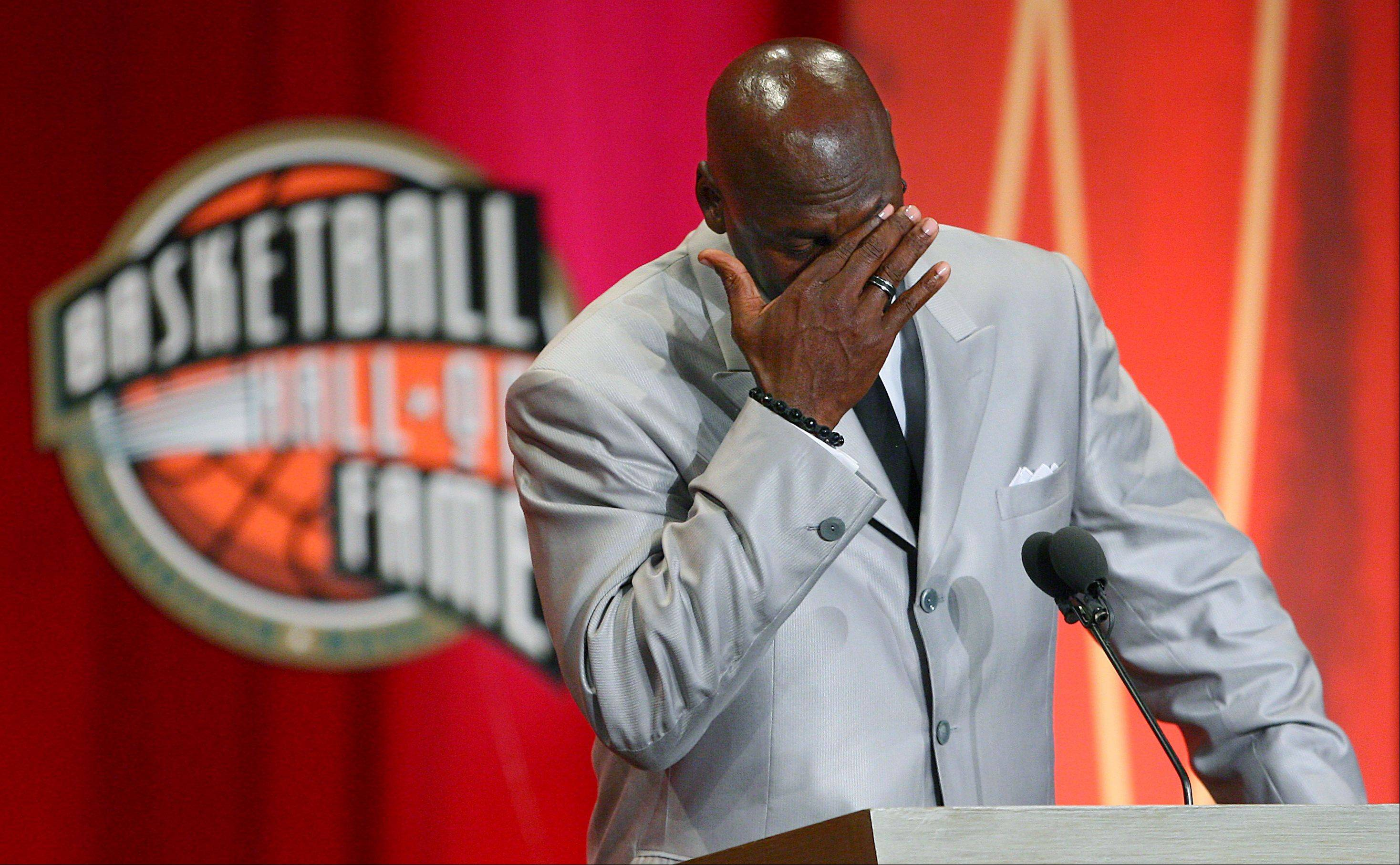 Former Chicago Bulls and Washington Wizards guard Michael Jordan becomes emotional as he take the stage during his enshrinement ceremony into the Naismith Basketball Hall of Fame in Springfield, Mass., Friday, Sept. 11, 2009.