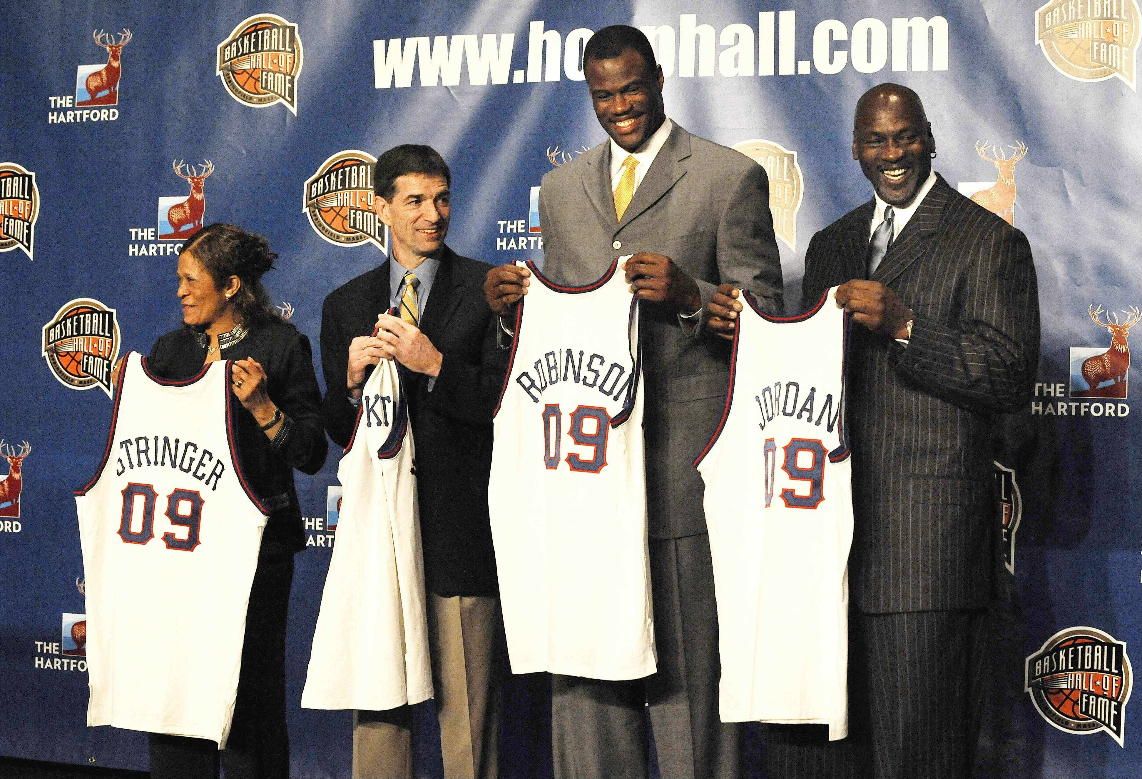 From left, Rutgers women's coach C. Vivian Stringer, and former NBA basketball players John Stockton, David Robinson and Michael Jordan hold jerseys Monday, April 6, 2009, in Detroit, at the announcement that they were elected to the Basketball Hall of Fame. Utah Jazz coach Jerry Sloan is also part of the 2009 class.