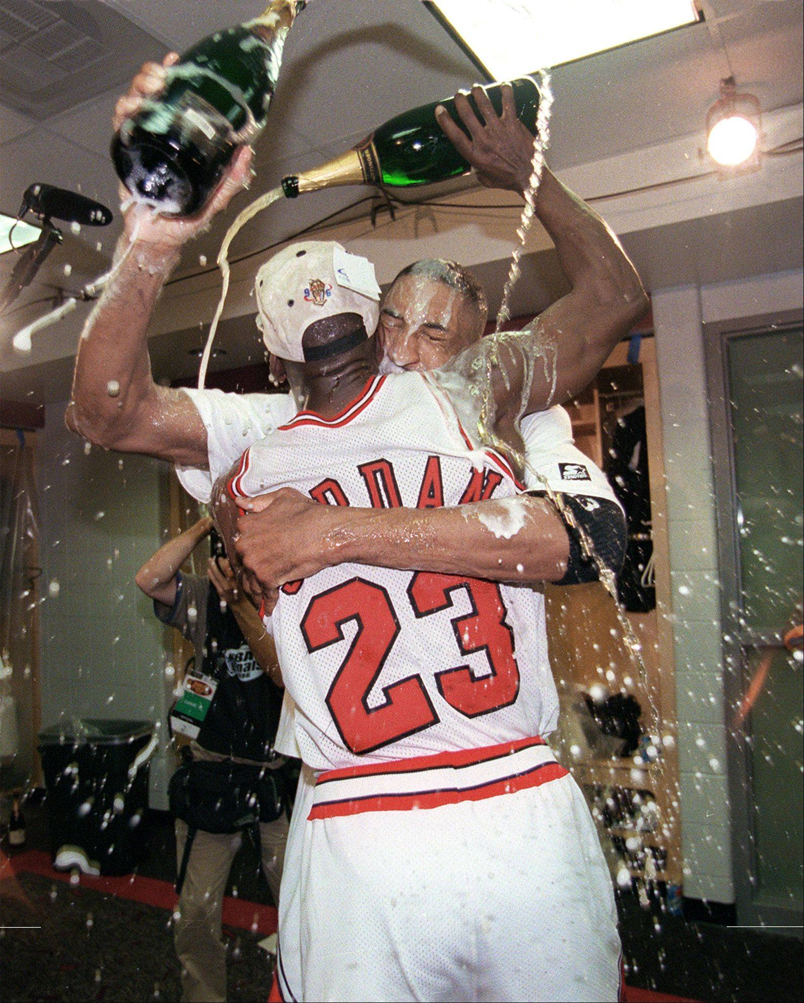 Scottie Pippen and Michael Jordan celebrate their 1996 victory in the Bulls locker room.