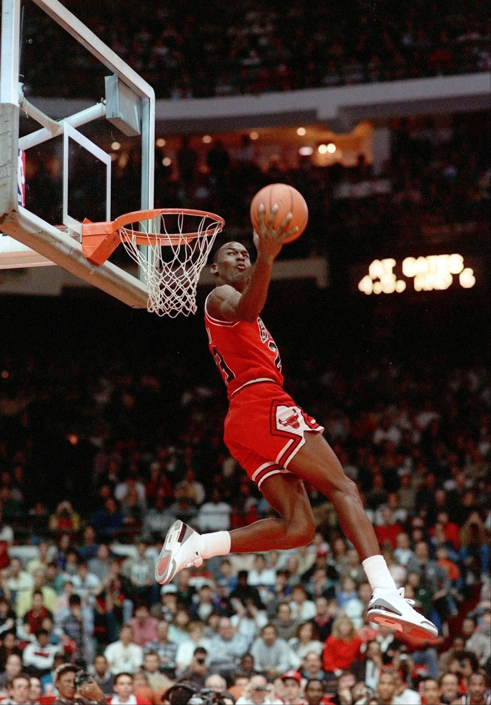 In this Feb. 6, 1988 file photo, Michael Jordan of the Chicago Bulls dunks during the slam-dunk competition of the NBA All-Star weekend in Chicago, Ill. On Friday, Sept. 11, 2009, Jordan will be enshrined at the Basketball Hall of Fame.