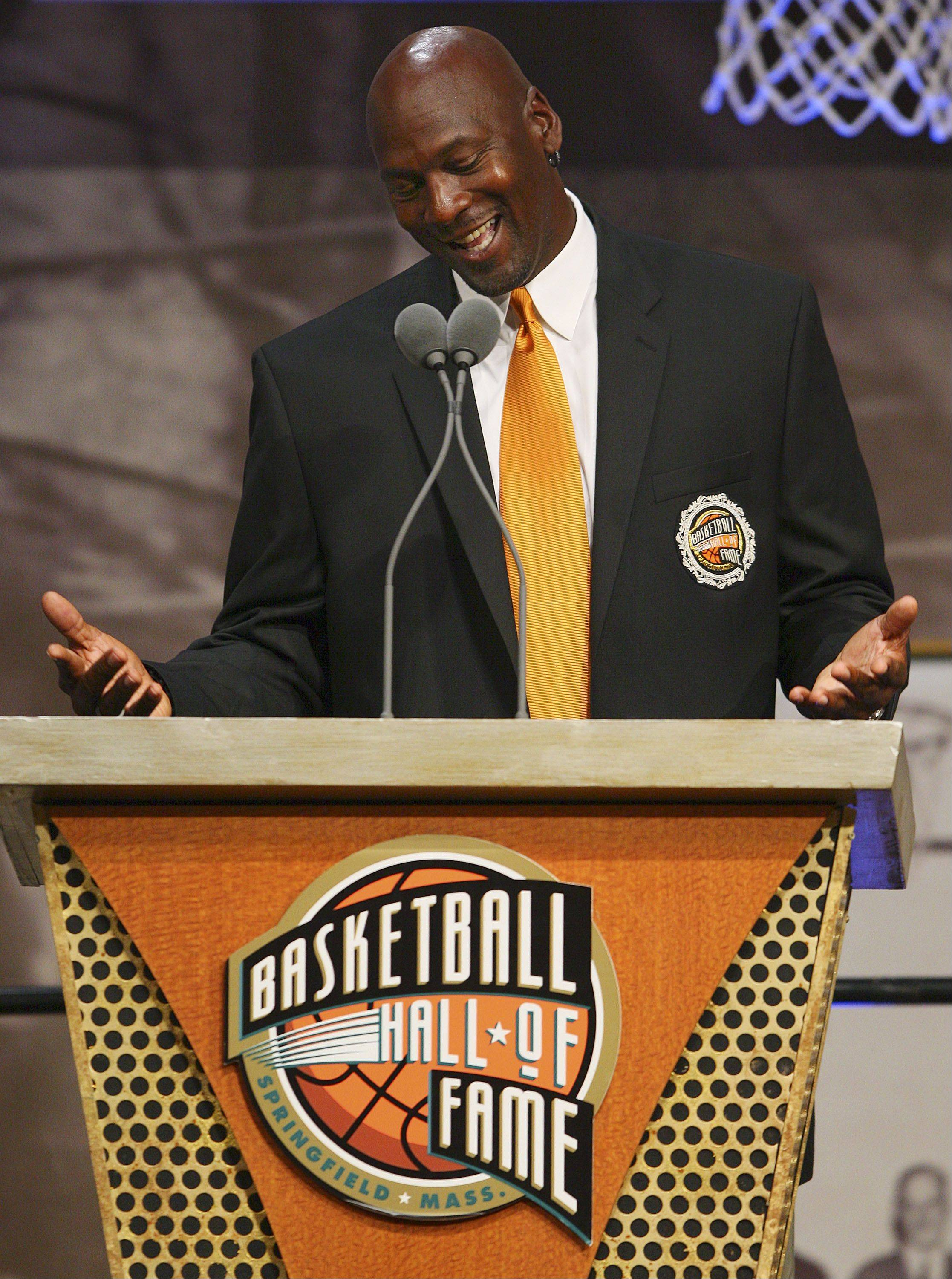 Former Chicago Bulls and Washington Wizards guard Michael Jordan laughs as he answers a reporter's question during a media availability before his enshrinement in the Basketball Hall of Fame in Springfield, Mass., Friday morning, Sept. 11, 2009.