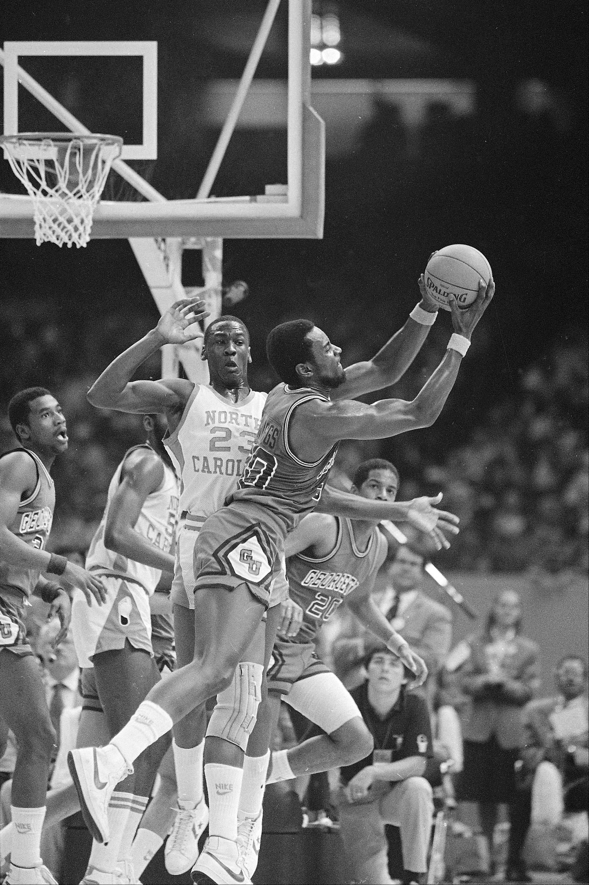 Georgetown's Ed Springs takes a rebound away from North Carolina's Michael Jordan (23) during the NCAA championship at the Superdome in New Orleans, March 30, 1982. Jordan scored 16 points and the winning basket as the Tar Heels defeated the Hoyas, 63-62.