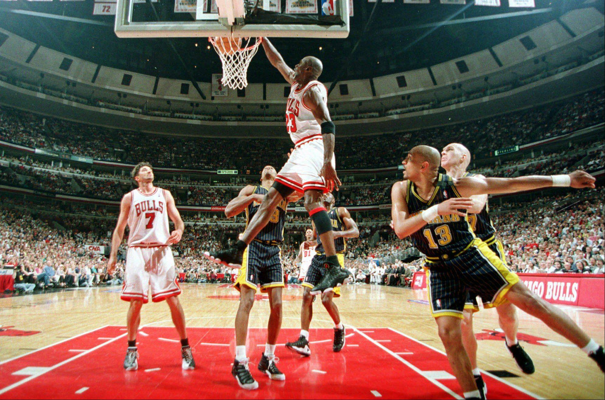 Michael Jordan dunks for two against the Indiana Pacers during Game One of the Eastern Conference Finals Sunday, May 17, 1998, at the United Center in Chicago.