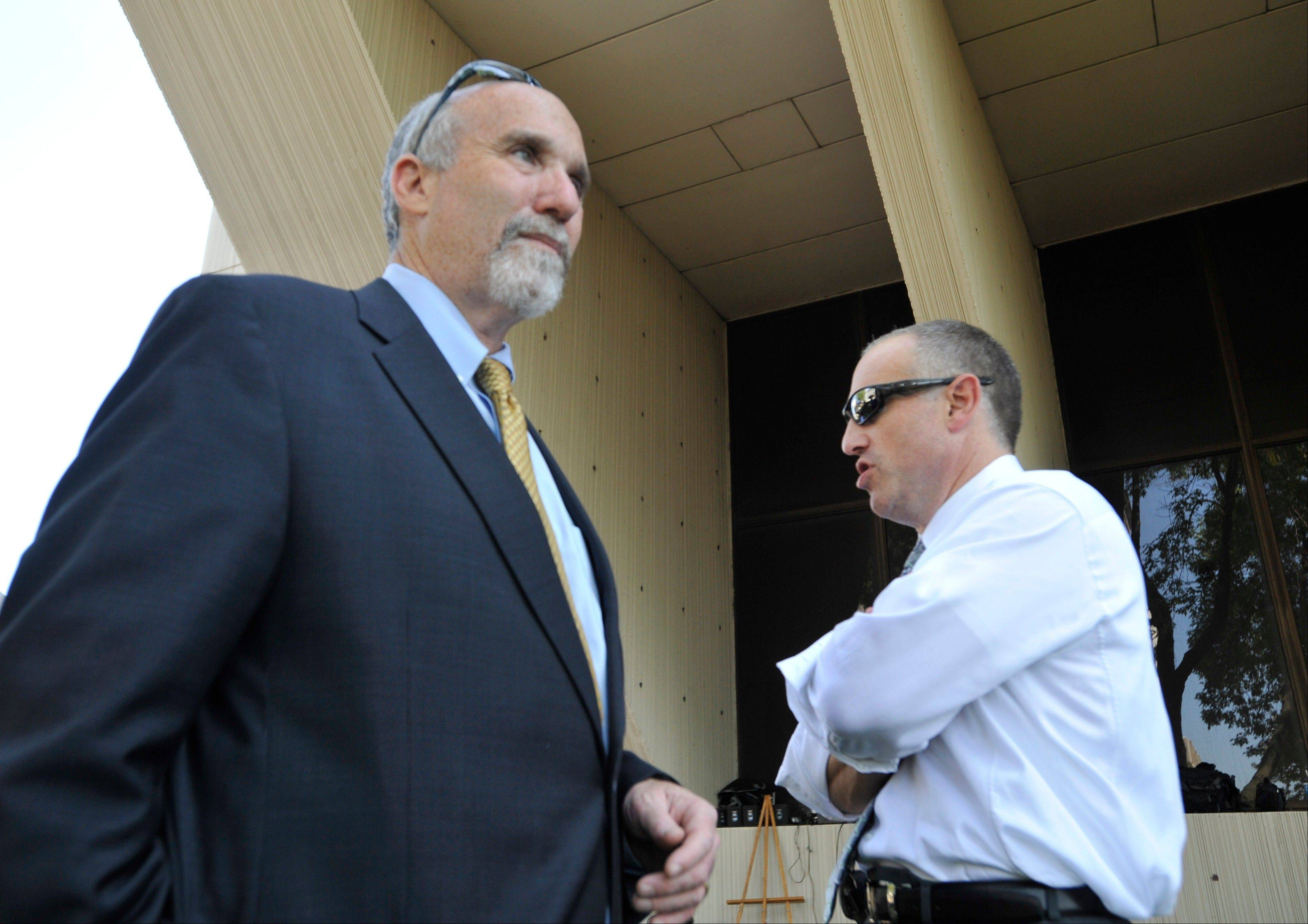 Attorneys Joel Brodsky, left, and Steven Greenberg confer outside the Will County courthouse during the second day of jury deliberations in Drew Peterson�s murder trial last September. Now Brodsky has filed a defamation suit against Greenberg, who says Brodsky did a shoddy job of defending Peterson.