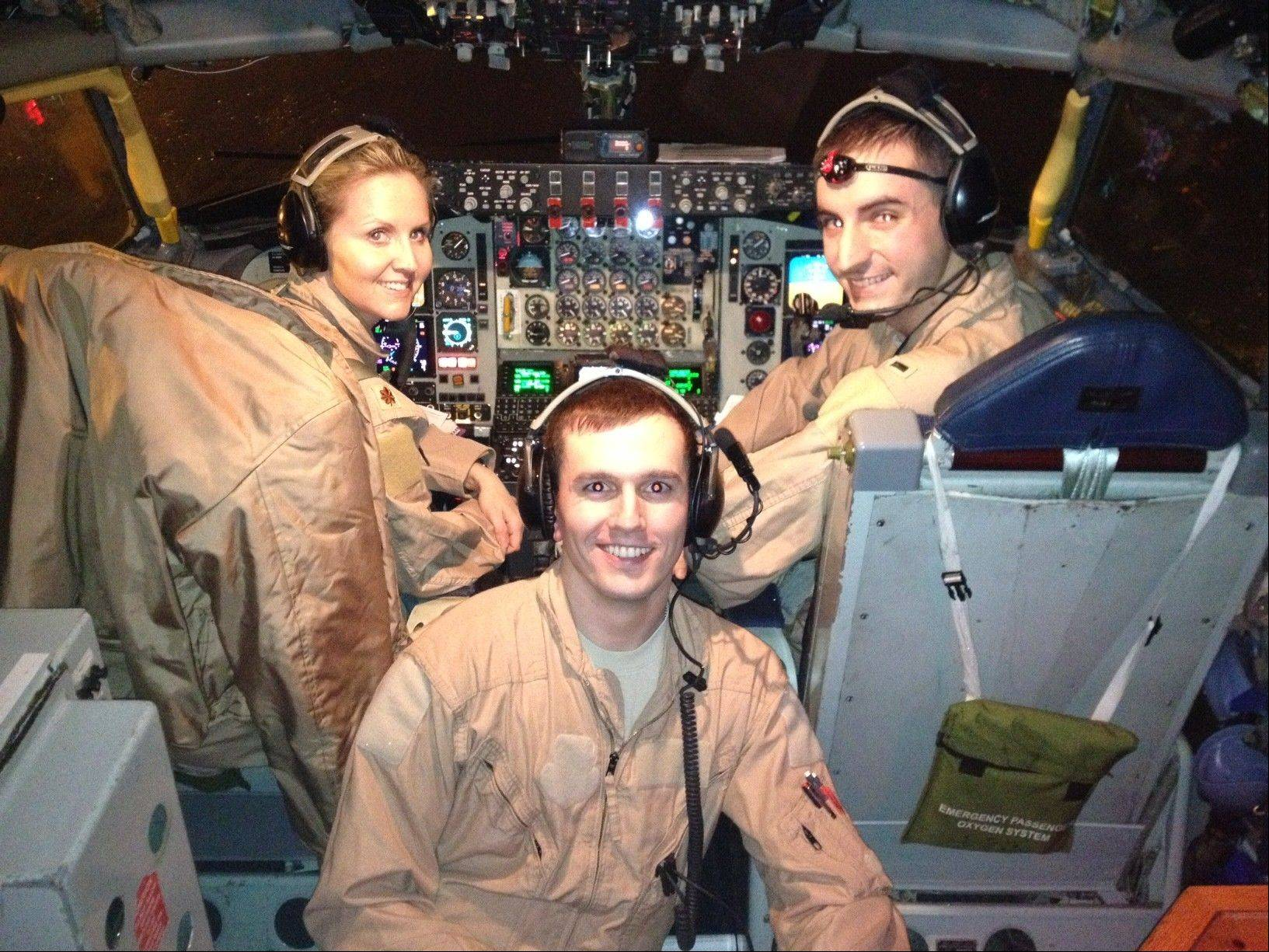 U.S. Air Force Maj. Gina Stramaglio of the 351st Expeditionary Air Refueling Squadron and her crew, 1st Lt. Paul Paskell, co-pilot, right, and Senior Airman Mike Danilowski, boom operator. On Jan. 27 the team conducted the first U.S. refueling mission in support of French fighter planes battling al-Qaida in Mali.