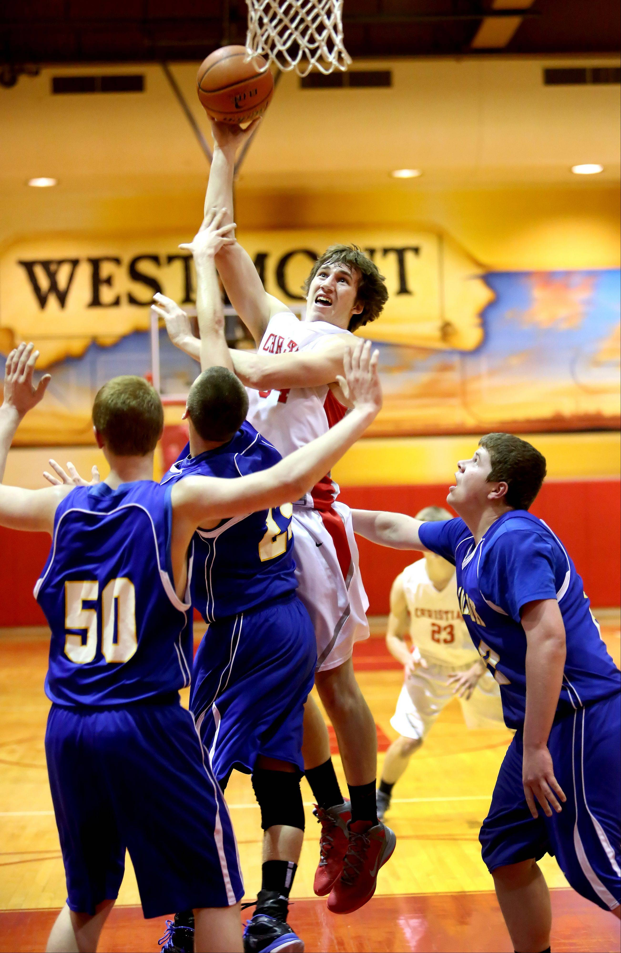 Cory Windle of Aurora Christian goes up for 2 points against Somonauk in Class 2A regional action Monday in Westmont.
