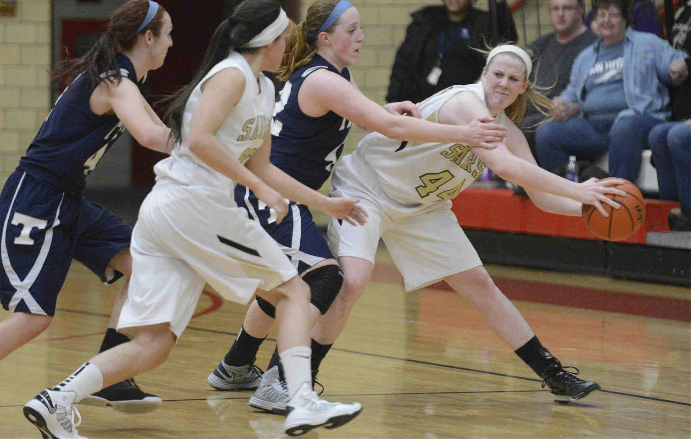 Streamwood�s Hannah McGlone keeps the ball away from Cary-Grove�s Olivia Jakubicek with seconds to play Monday in the Class 4A sectional game in Rockford.