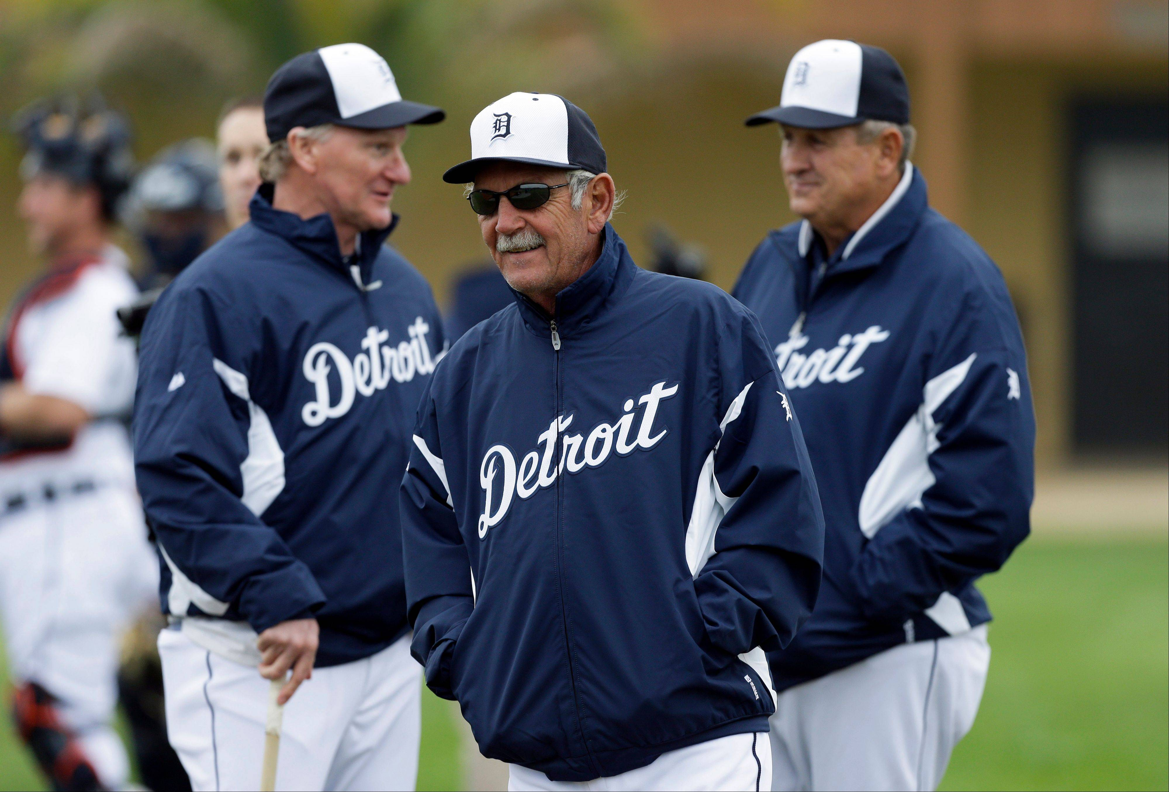 Associated Press Ever the pessimist, Detroit manager Jim Leyland, center, likes his team but insists the Tigers can't take it easy with the improved talent on the Indians, White Sox and Royals.
