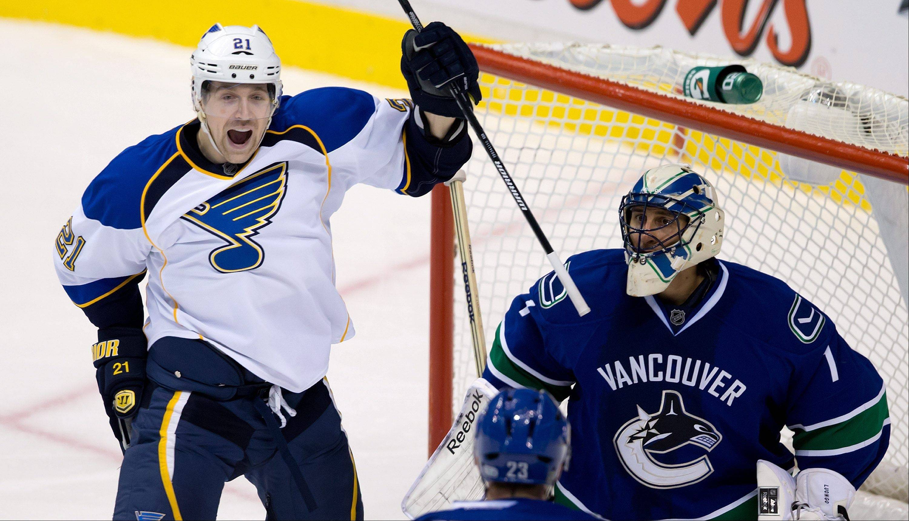 St. Louis Blues' Patrik Berglund celebrates a goal against Vancouver goalie Roberto Luongo in the third period Sunday. The Canucks lost in a shootout, 4-3, and now face the Blackhawks at the United Center.
