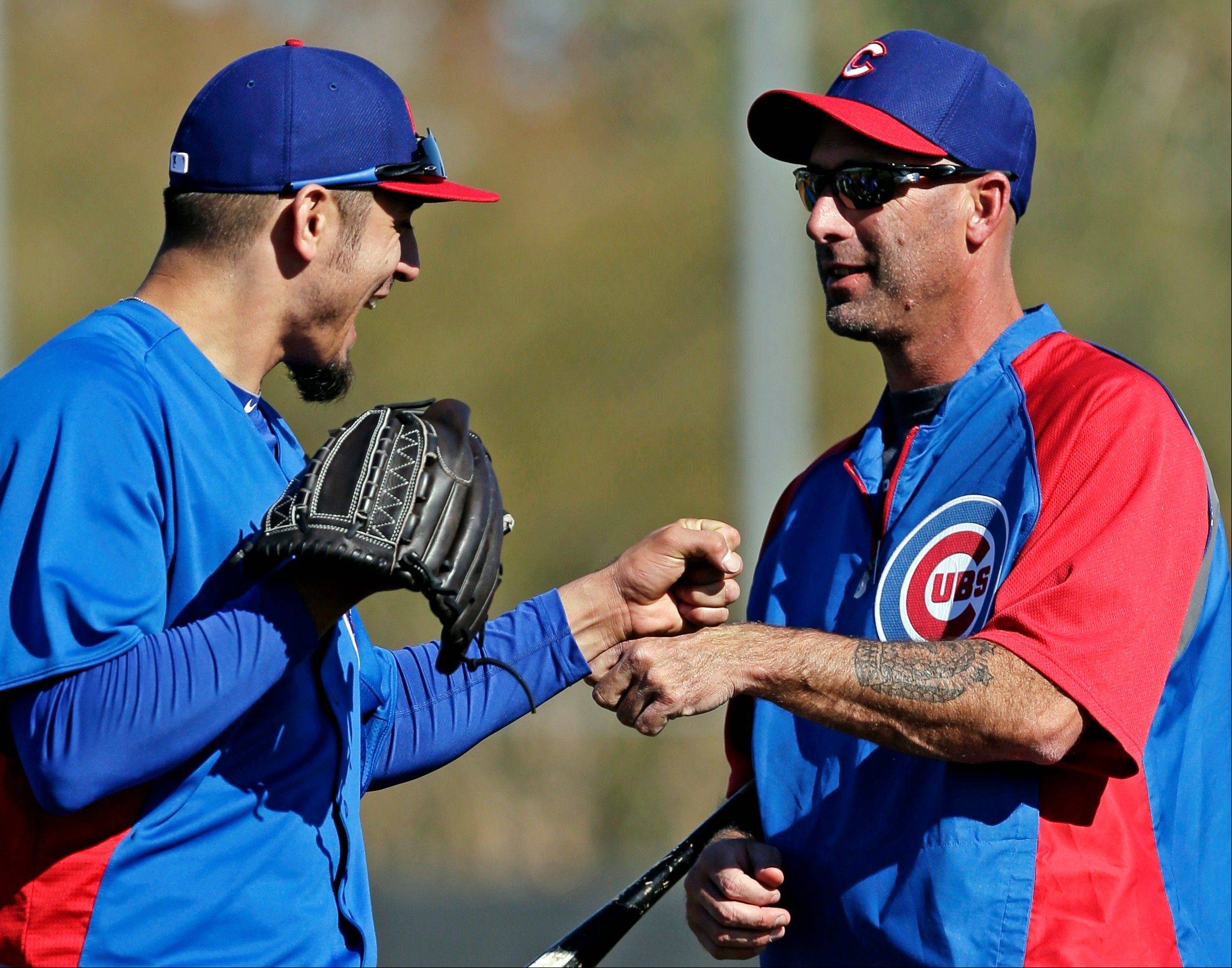 Cubs pitcher Matt Garza, shown here with manager Dale Sveum, right, will have an MRI exam on a lat muscle he strained during a batting practice session.