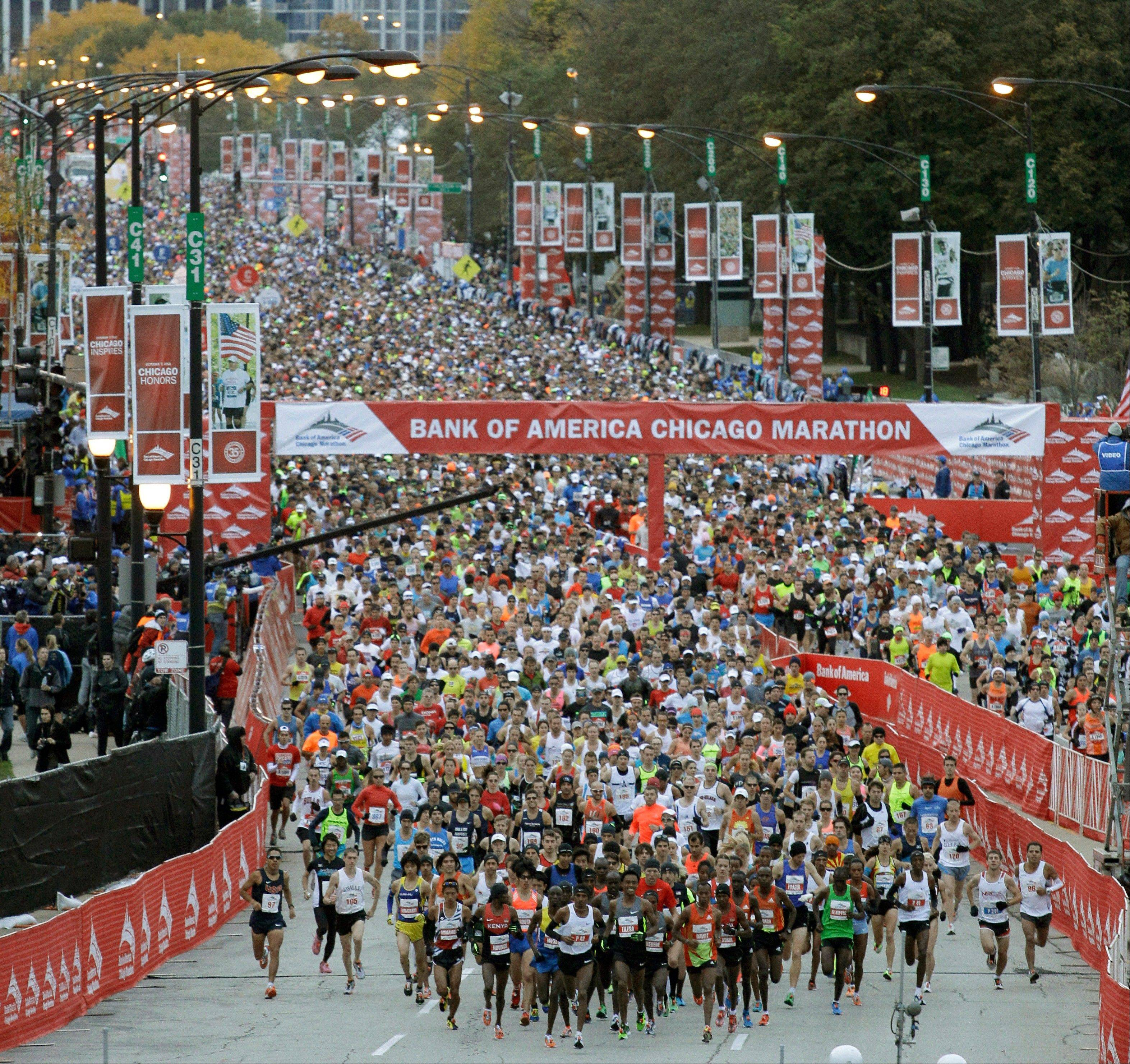 Runners leave the starting line during the 2012 Chicago Marathon.