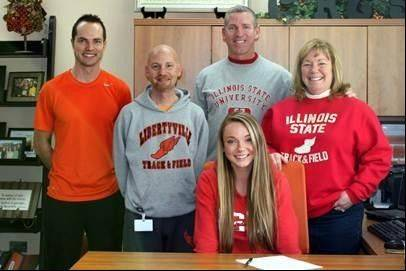 Haley Becker, front, is joined by, from left, Libertyville assistant track and field coach Bill Etnyre, Libertyville head track and field coach Tom Bizosky, and Becker�s dad and mom, Bryan and Peggy.