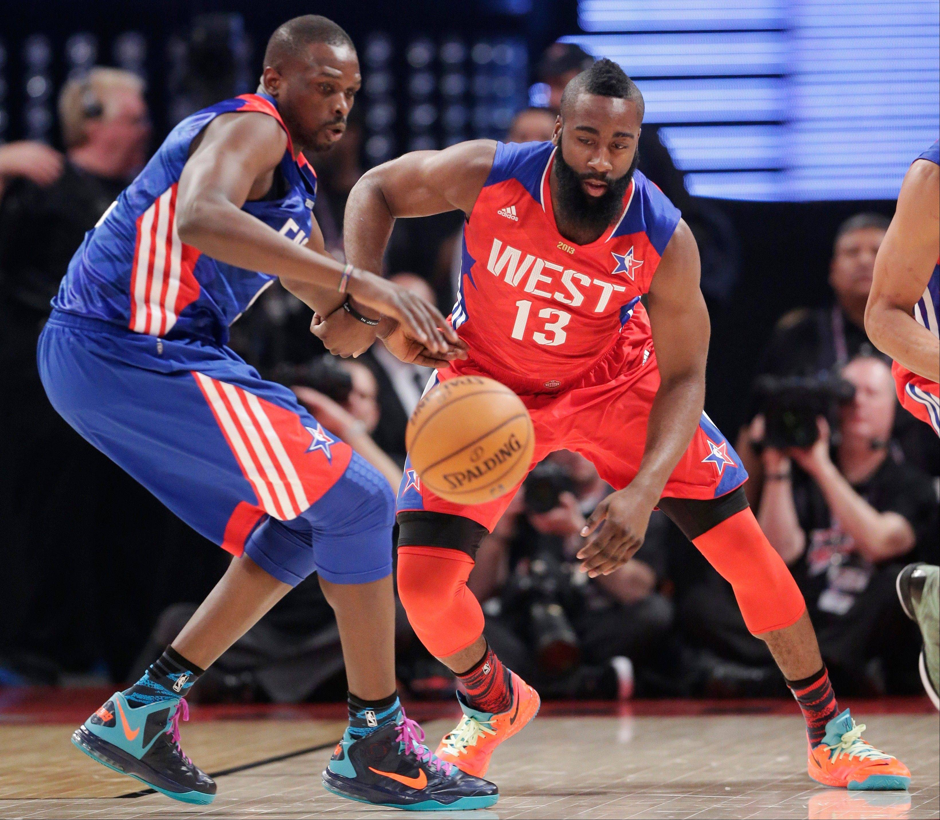 East Team's Luol Deng from Great Britain of the Chicago Bulls, left, and West Team's James Harden of the Houston Rockets go after a loose ball during the first half of the NBA All-Star basketball game Sunday in Houston.