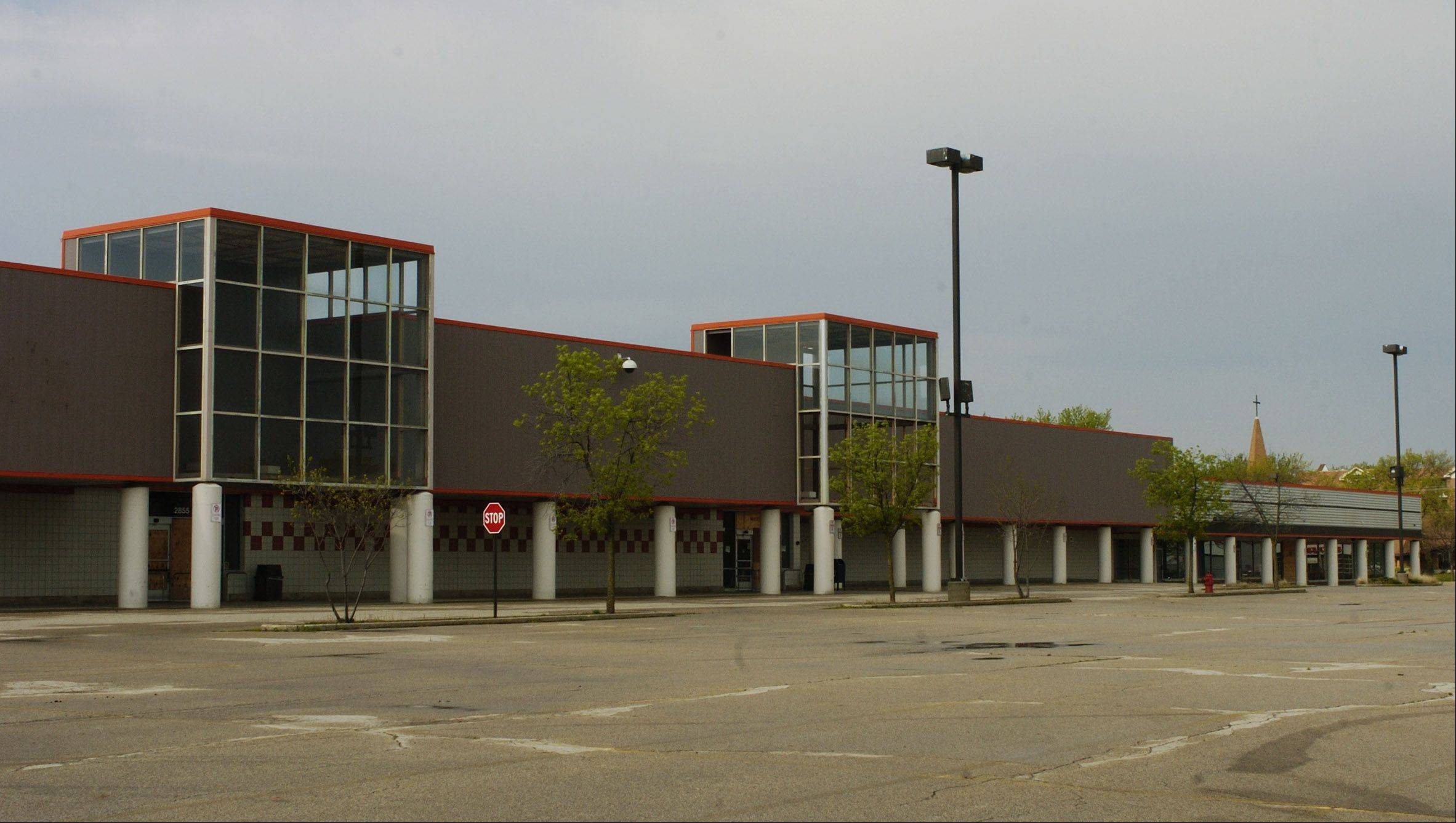 Exterior view of the mostly vacant shopping center on Kirchoff Road, now to be called Meadows Marketplace.