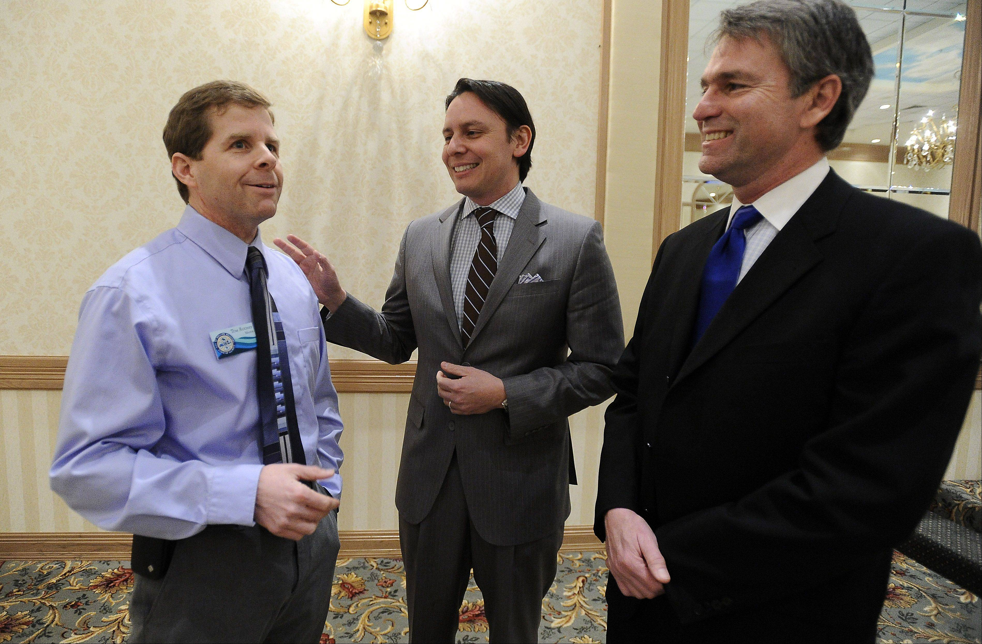 Rolling Meadows Mayor Tom Rooney, left, speaks with Javier Barrios, center and Tom Leigh both of Good Energy of Peoria at the chamber lunch.