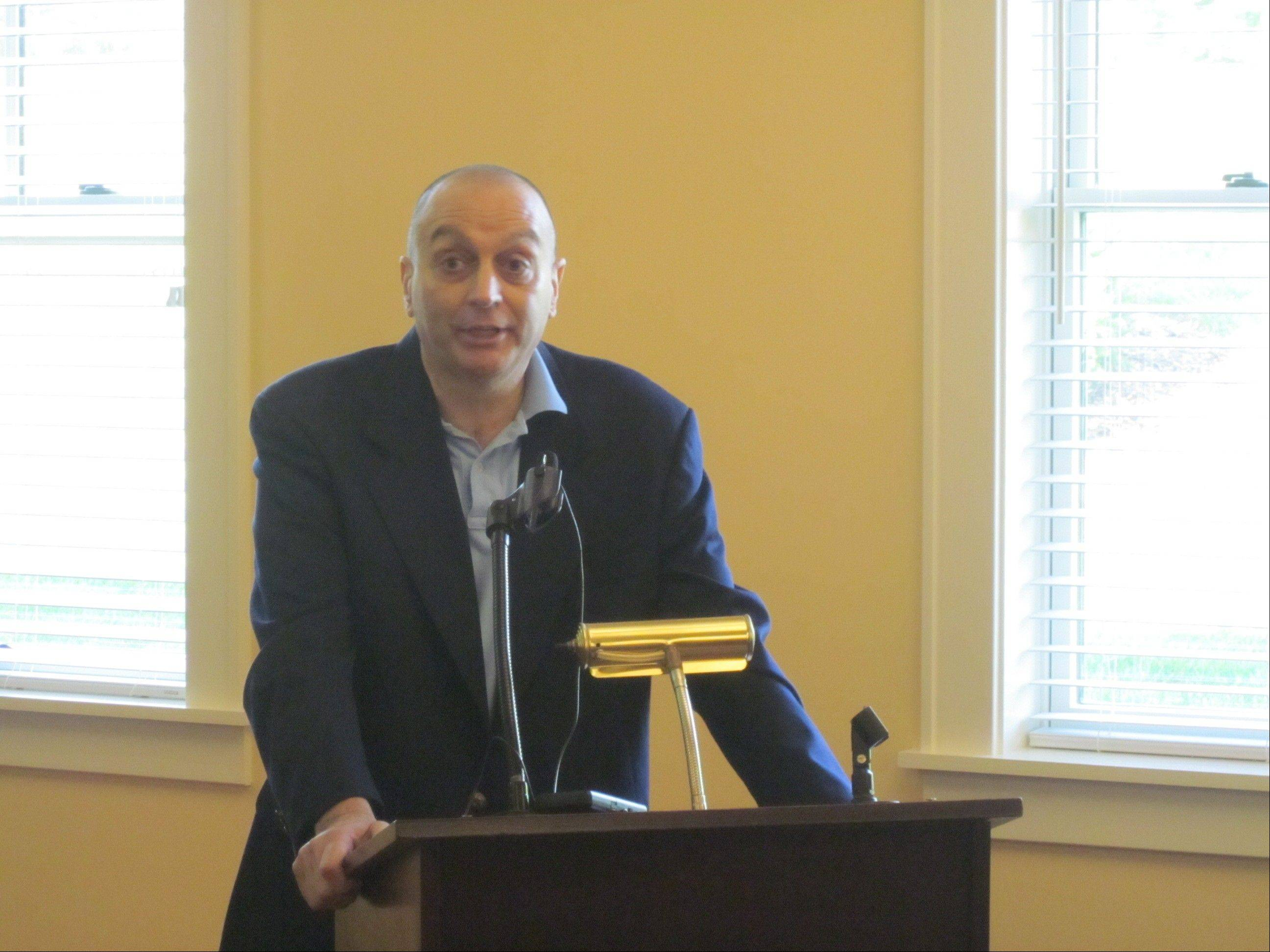 Geneva Alderman Ralph Dantino, a client of the LivingWell Cancer Resource Center, speaks at the grand opening of its new facility in May 2012.