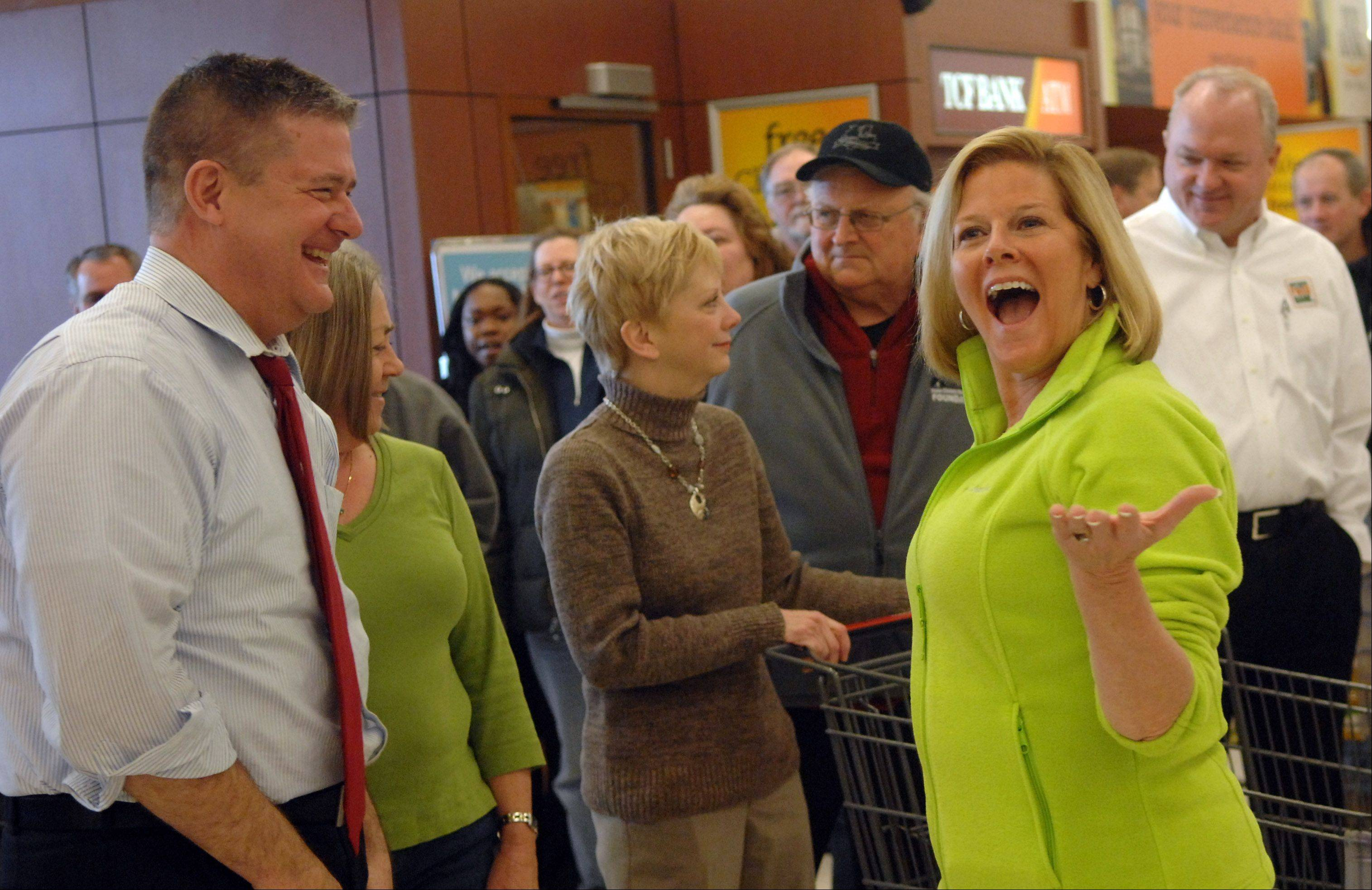 State Treasurer Dan Rutherford and State Sen. Karen McConnaughay joke before the start of the Kane County Farm Bureau's Food Check-Out Challenge Monday at Jewel in Batavia.